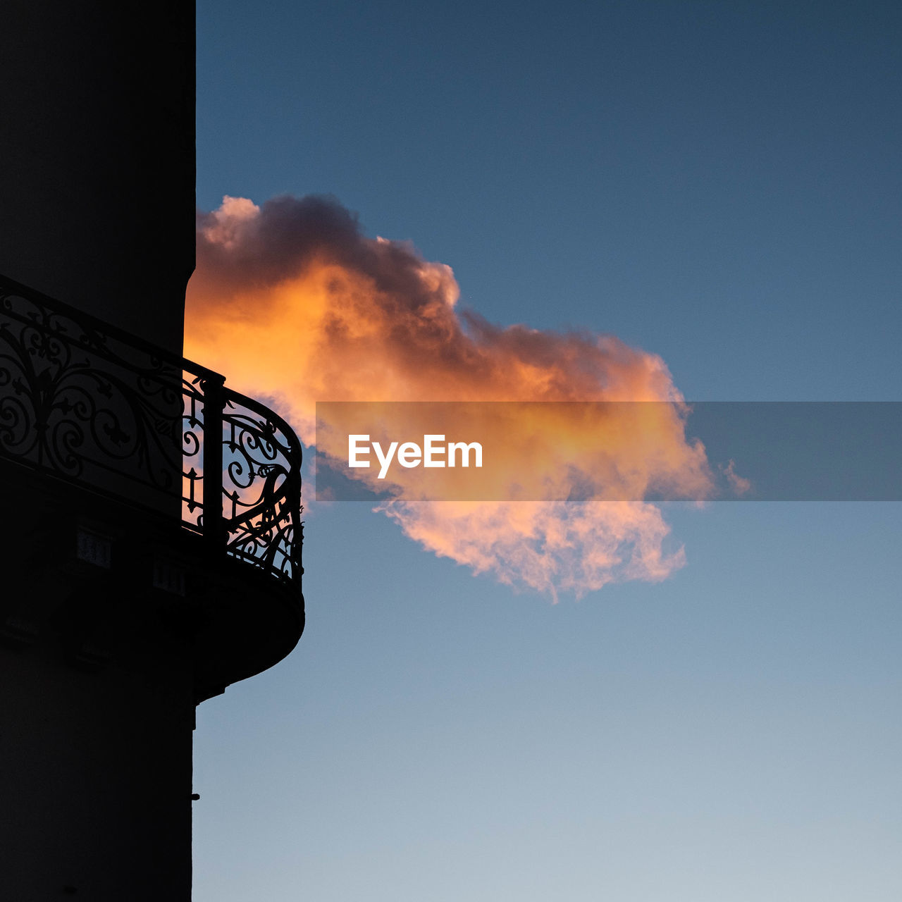 A lonely cloud kidding a balcony in the golden hour.