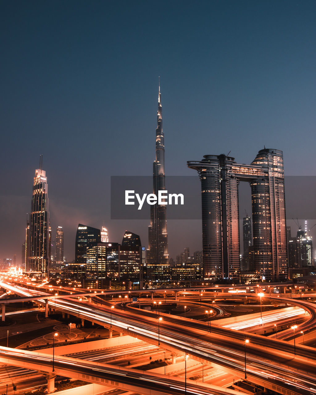 Dubai at sunset with light trails on the highway