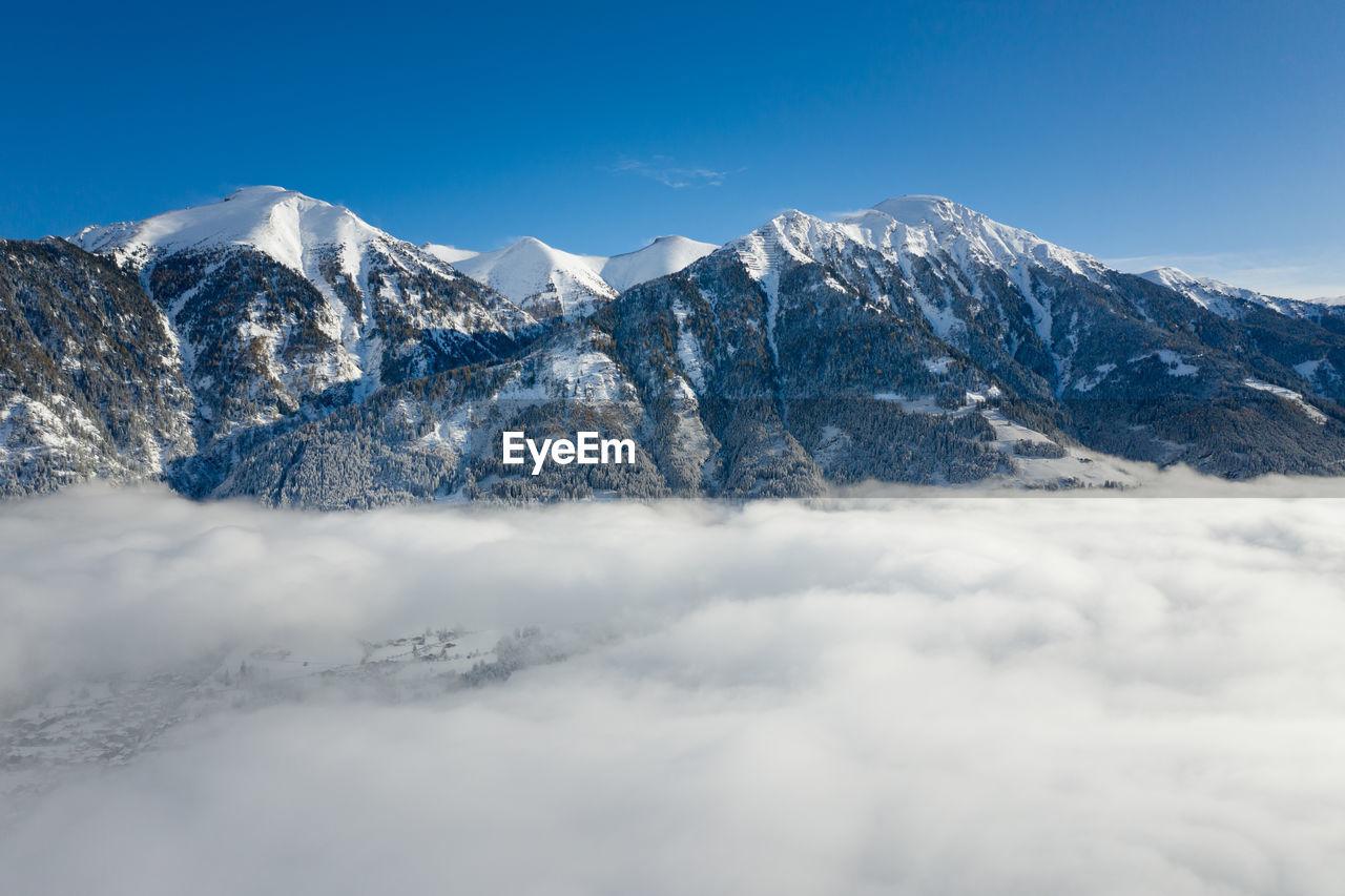 Aerial panoramic view of winter wonderland in the gastein valley, salzburg, austria.