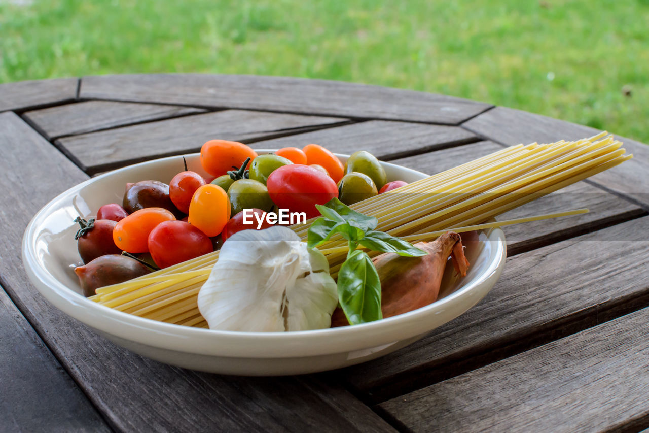 Spaghetti Ingredients In Bowl On Table