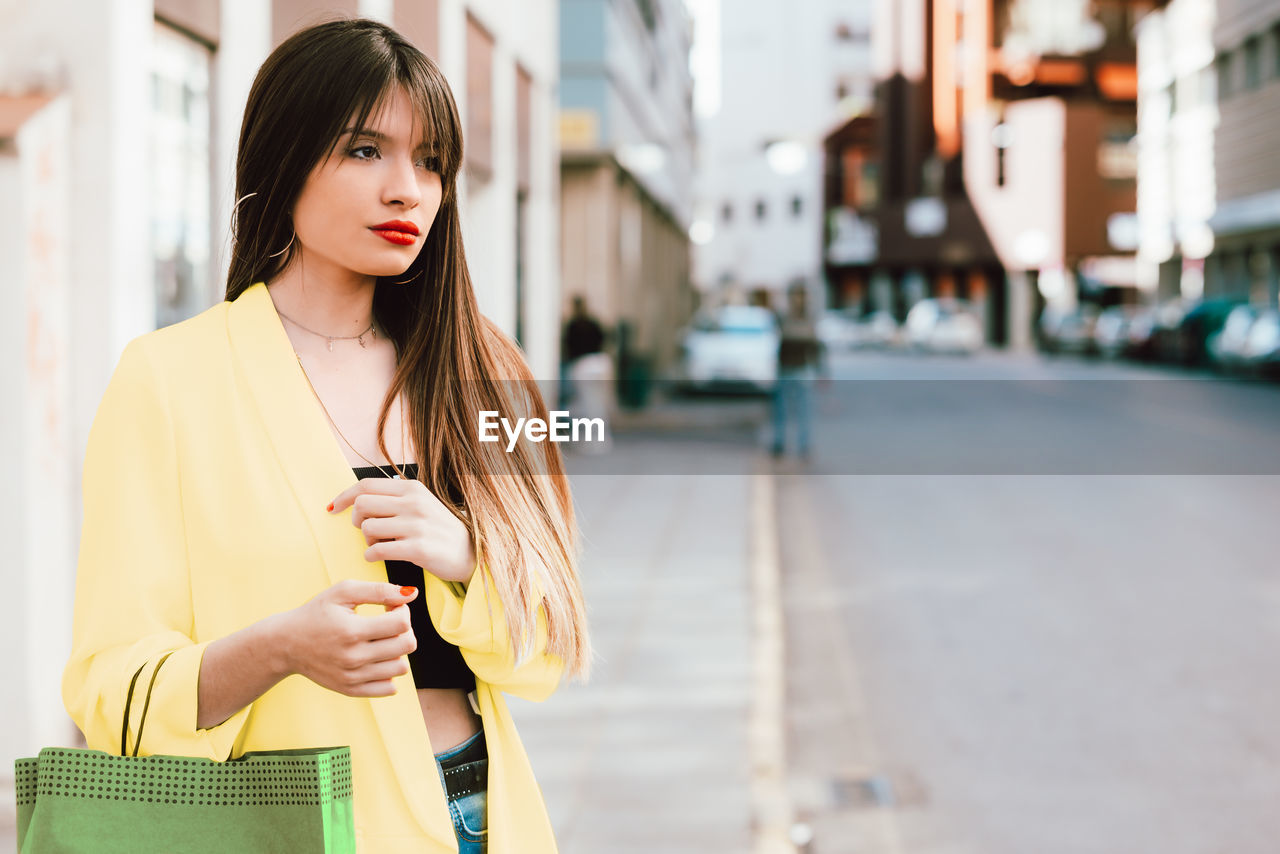Young woman standing in city