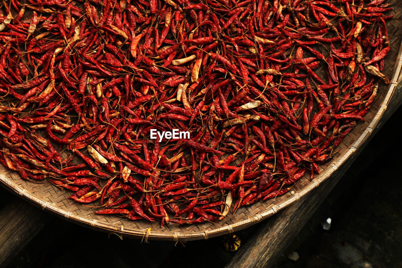 High Angle View Of Dry Red Chili Peppers In Wicker