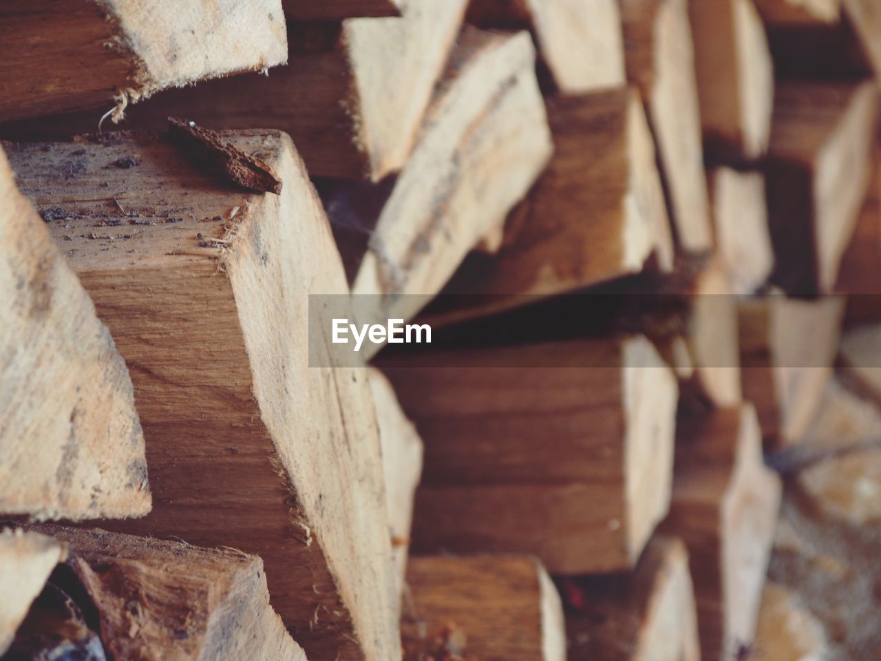 wood - material, wood, log, stack, timber, tree, no people, firewood, close-up, large group of objects, lumber industry, forest, full frame, abundance, deforestation, woodpile, backgrounds, heap, fuel and power generation, selective focus