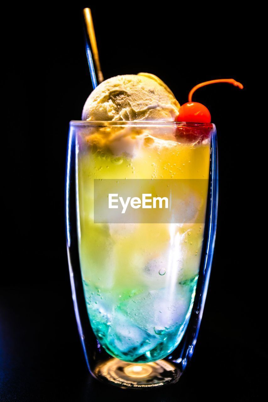 glass, food and drink, drink, refreshment, drinking glass, household equipment, close-up, indoors, cold temperature, still life, food, alcohol, freshness, straw, drinking straw, no people, fruit, cocktail, studio shot, glass - material, black background, ice, rum, tropical drink