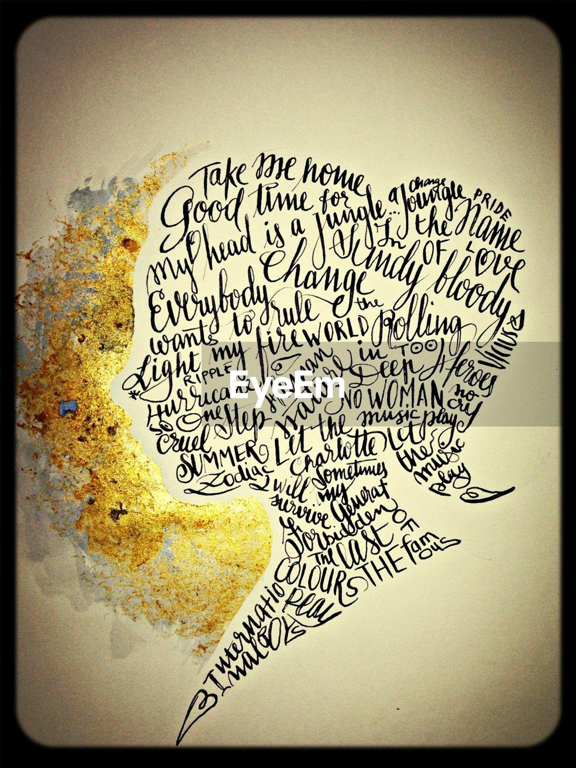 text, western script, transfer print, communication, auto post production filter, indoors, paper, close-up, message, creativity, art, non-western script, art and craft, still life, studio shot, heart shape, handwriting, information, love, capital letter