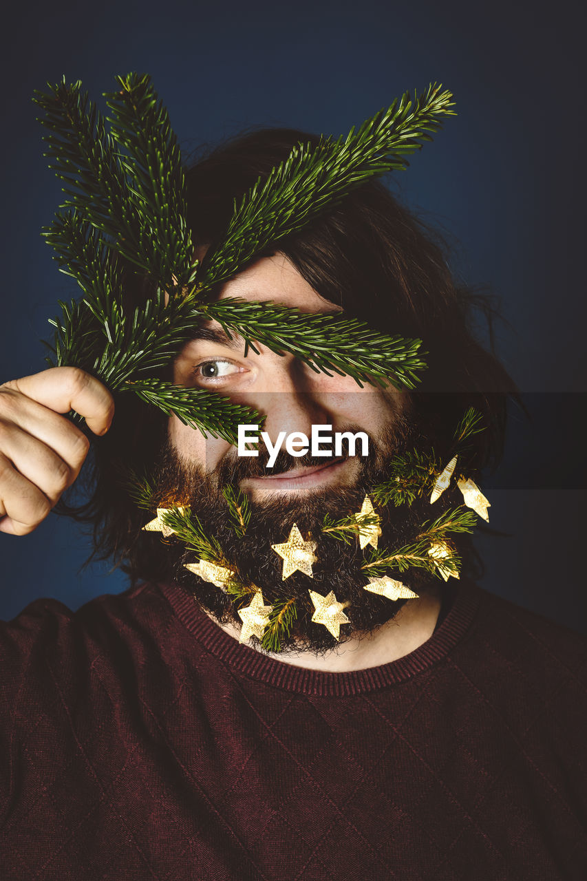 Bearded Man Holding Christmas Decoration