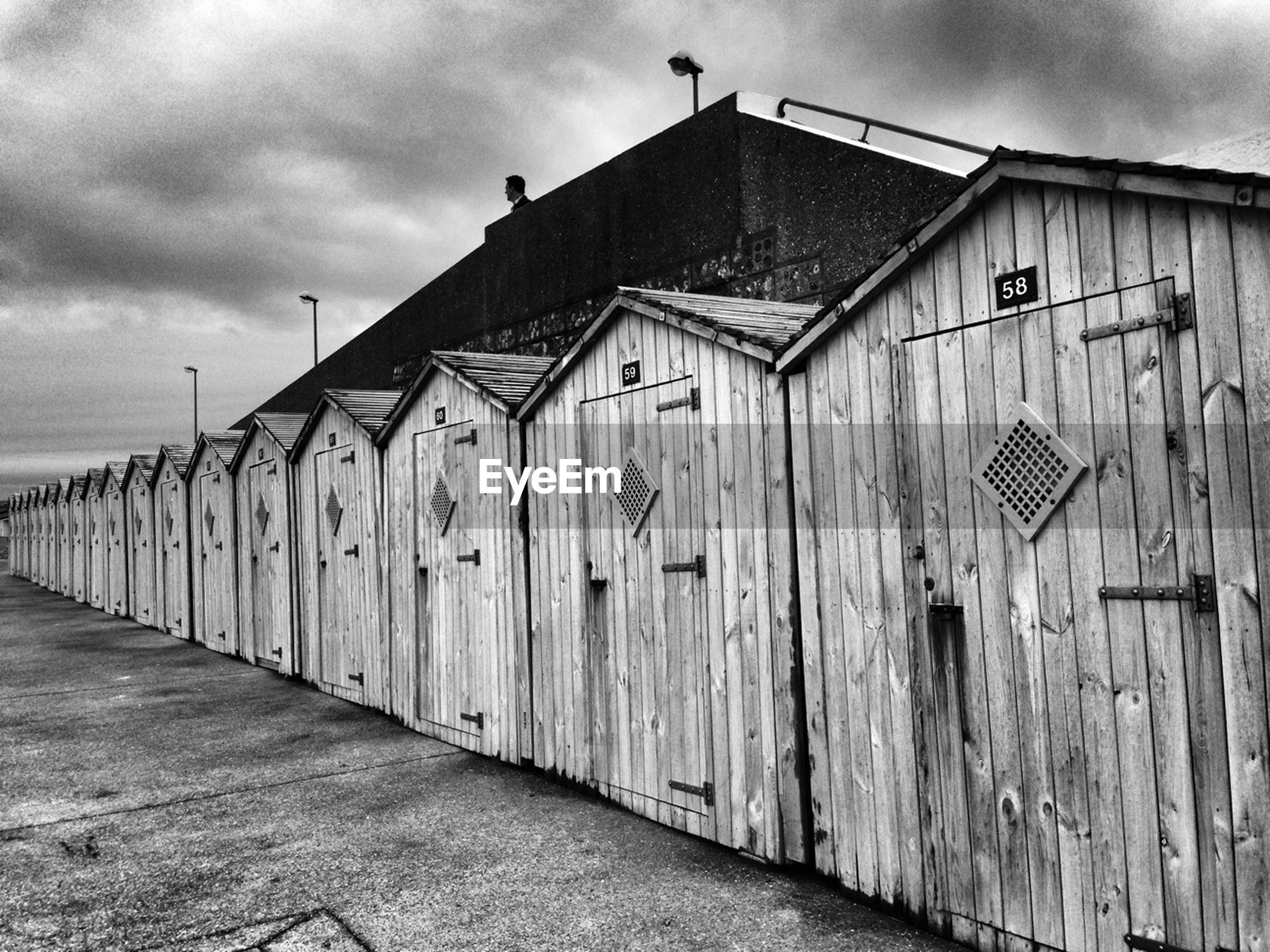 architecture, built structure, sky, building exterior, cloud - sky, cloudy, cloud, bird, day, outdoors, overcast, house, no people, door, animal themes, low angle view, street, weather, wood - material, old