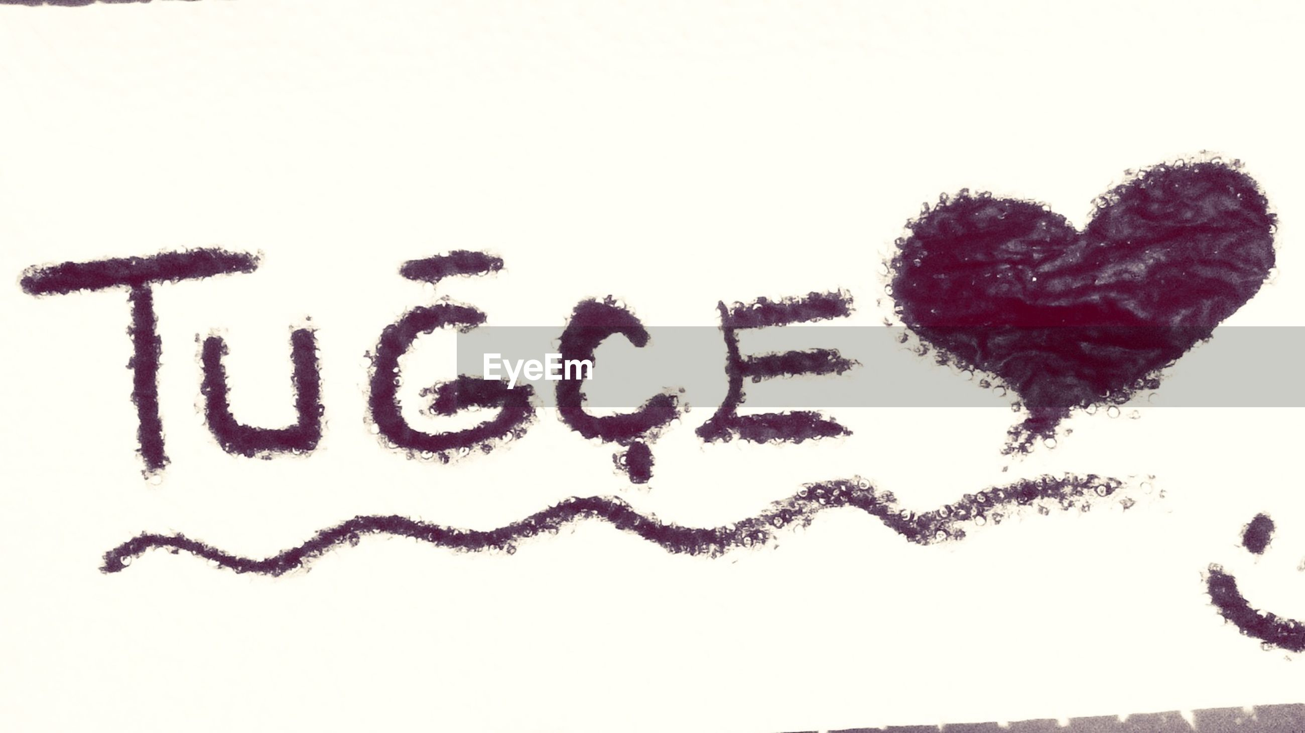 text, western script, communication, art, creativity, art and craft, studio shot, copy space, white background, capital letter, message, wall - building feature, paper, animal representation, close-up, human representation, low angle view, information, love, heart shape