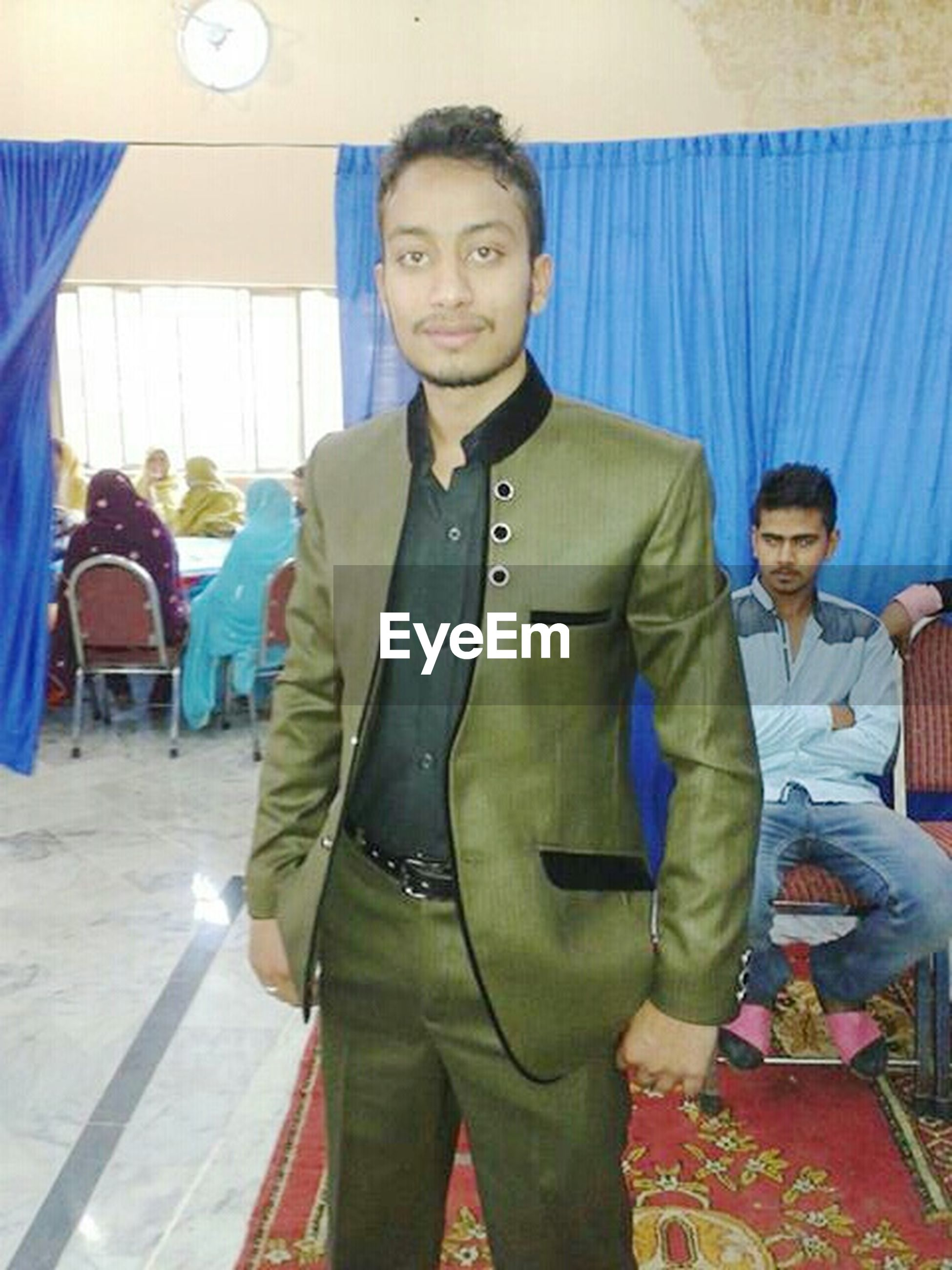 casual clothing, lifestyles, person, portrait, looking at camera, front view, standing, indoors, happiness, leisure activity, smiling, three quarter length, young men, young adult, full length, togetherness, traditional clothing