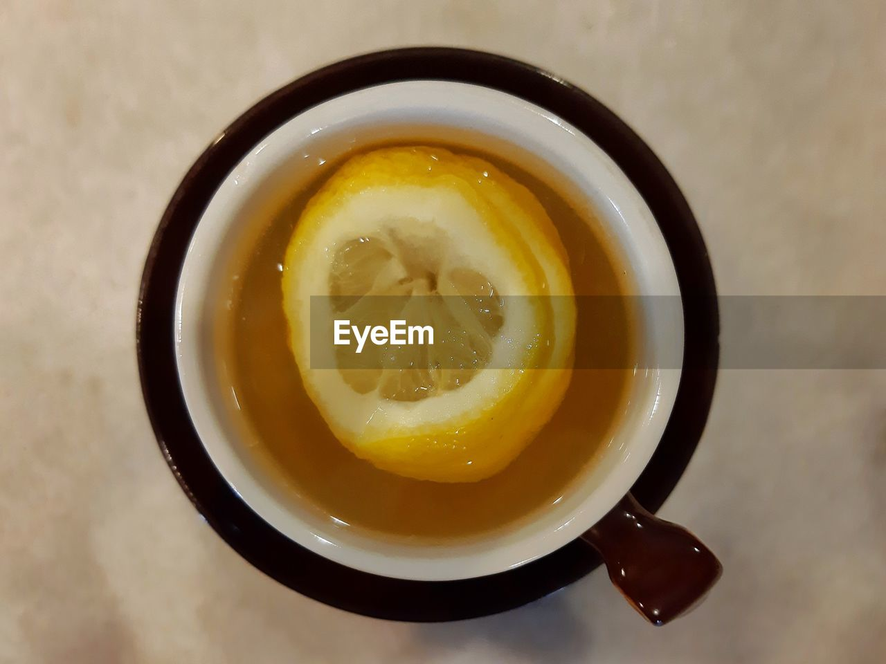 food and drink, food, freshness, healthy eating, directly above, still life, indoors, wellbeing, ready-to-eat, no people, high angle view, close-up, table, drink, yellow, cup, refreshment, bowl, serving size, temptation, soup bowl, tea cup