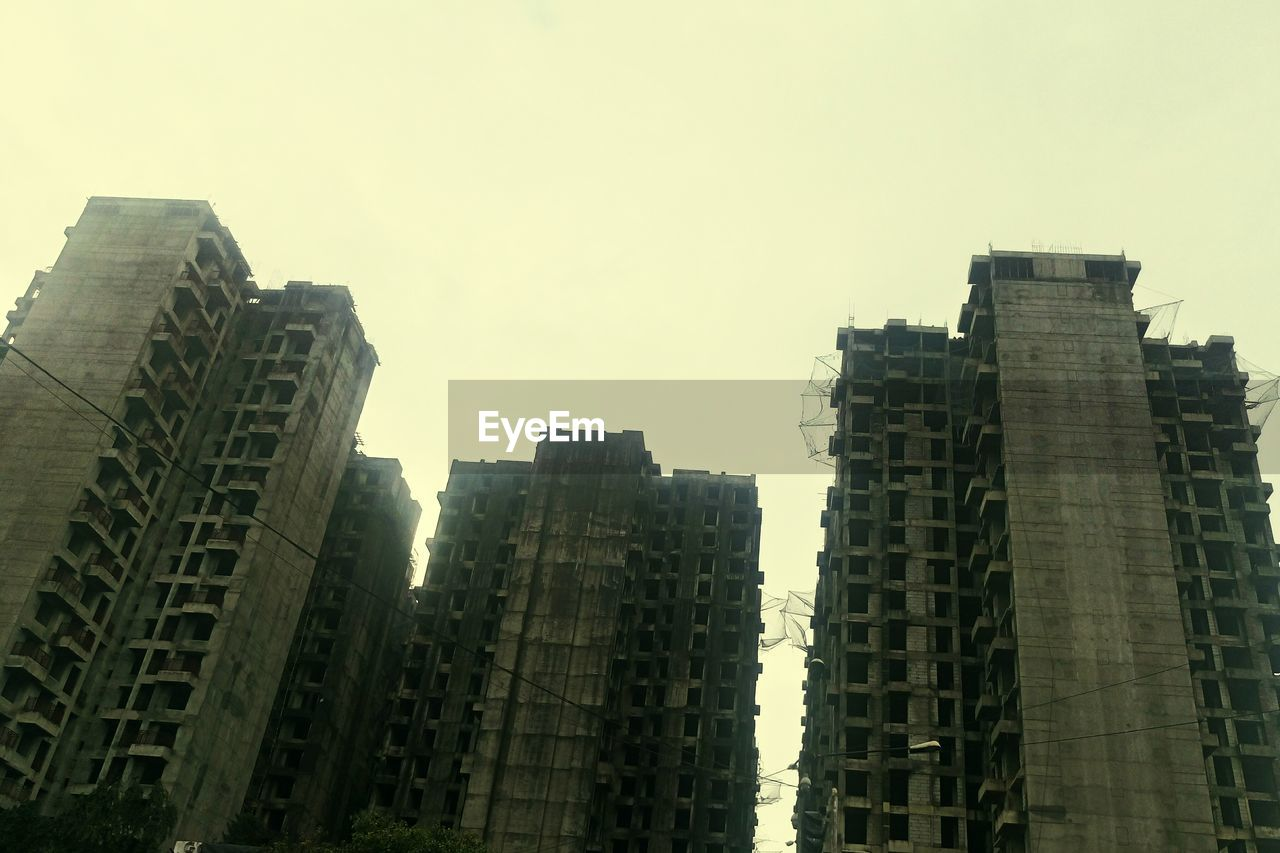 architecture, skyscraper, building exterior, tower, built structure, low angle view, modern, no people, tall, city, sky, clear sky, travel destinations, outdoors, growth, day, cityscape