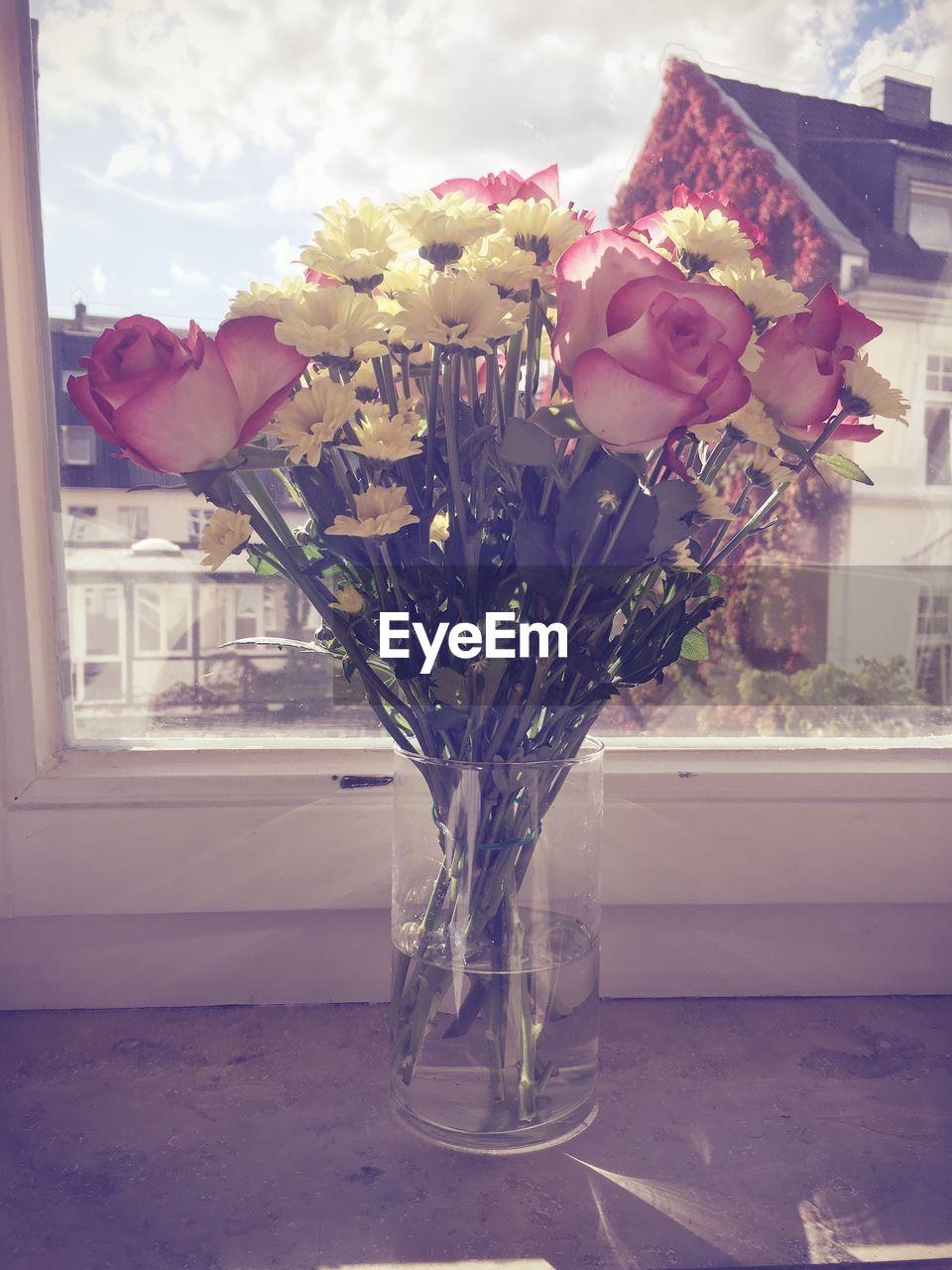 flower, vase, bouquet, fragility, petal, flower arrangement, nature, flower head, freshness, rose - flower, beauty in nature, tulip, indoors, close-up, no people, pink color, plant, home interior, day, flower shop, hyacinth, blooming, florist