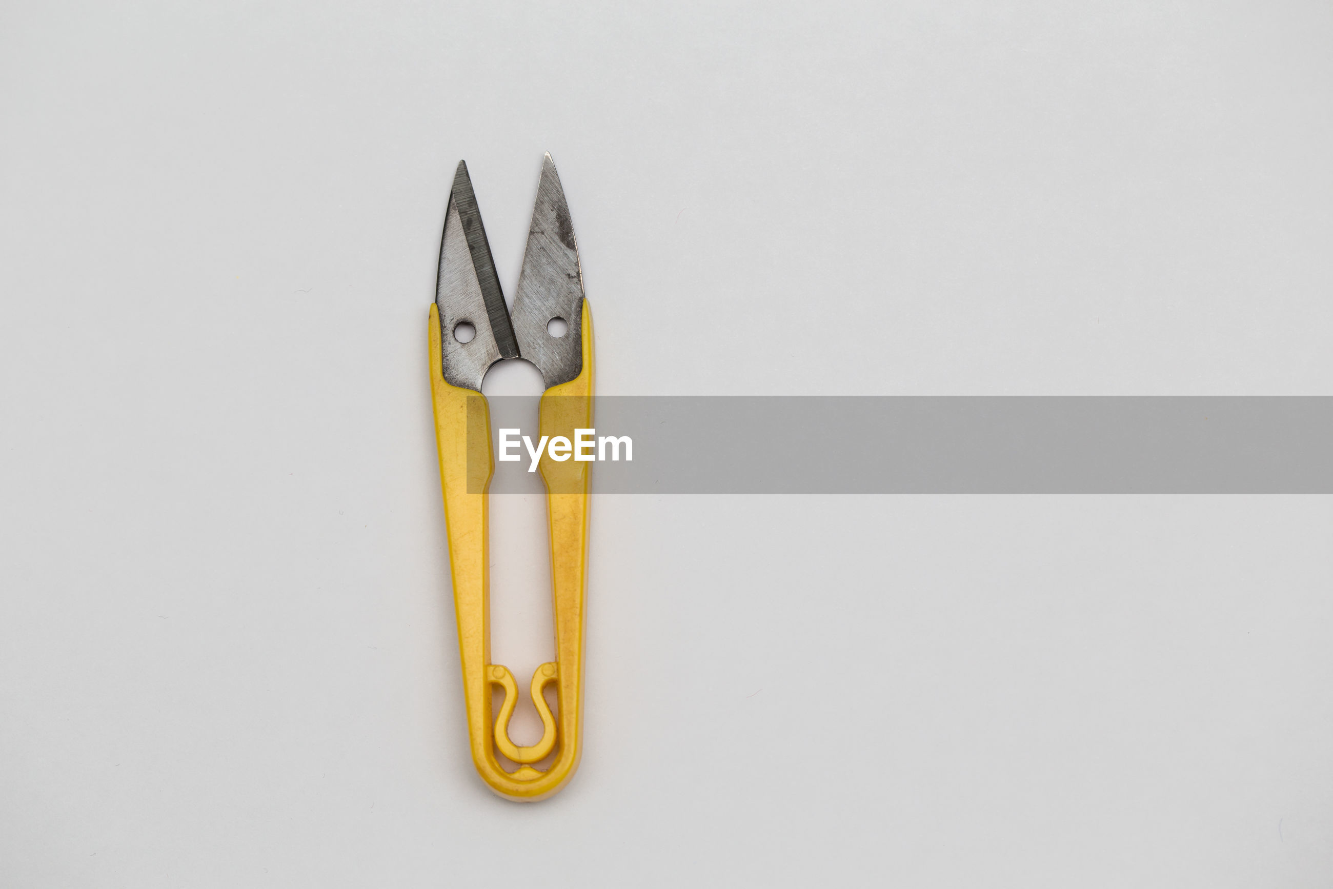 Close-up of tool over white background