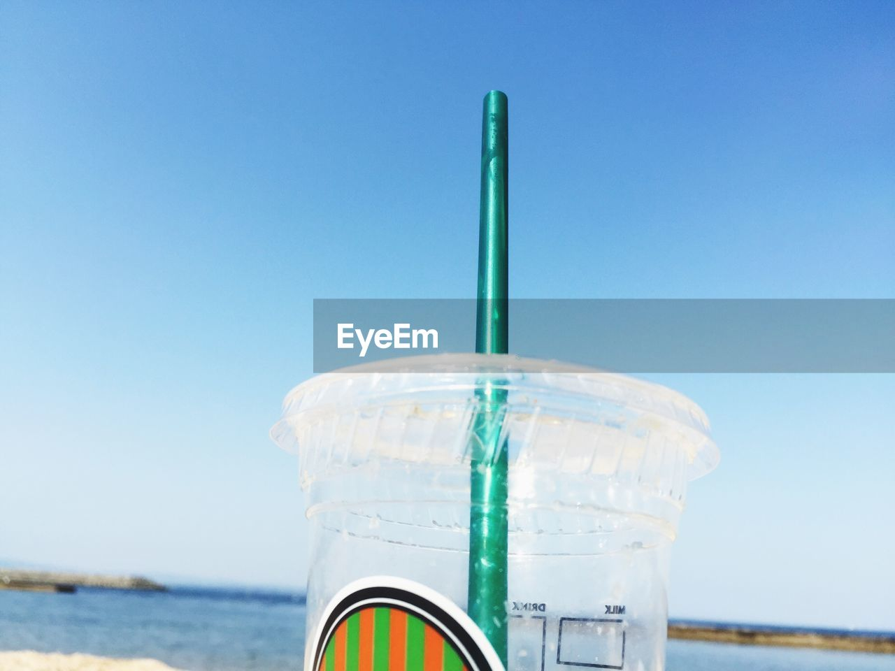water, drinking straw, sea, food and drink, day, blue, clear sky, drink, outdoors, close-up, no people, sky, nature, freshness