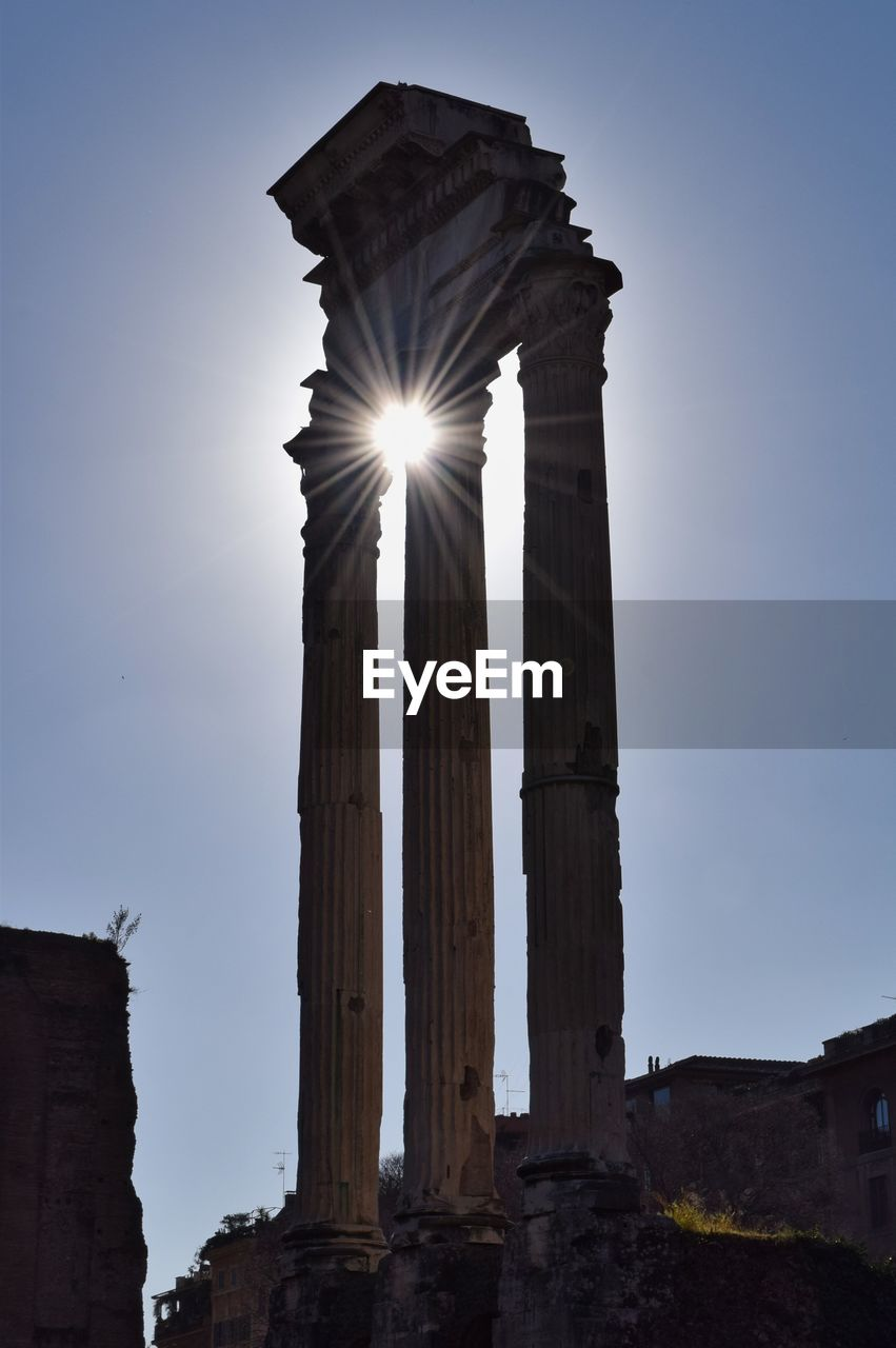 sky, architecture, low angle view, history, the past, built structure, nature, ancient, no people, travel destinations, building exterior, lens flare, sunlight, architectural column, travel, tourism, clear sky, old, sun, old ruin, outdoors, ancient civilization, ruined, archaeology