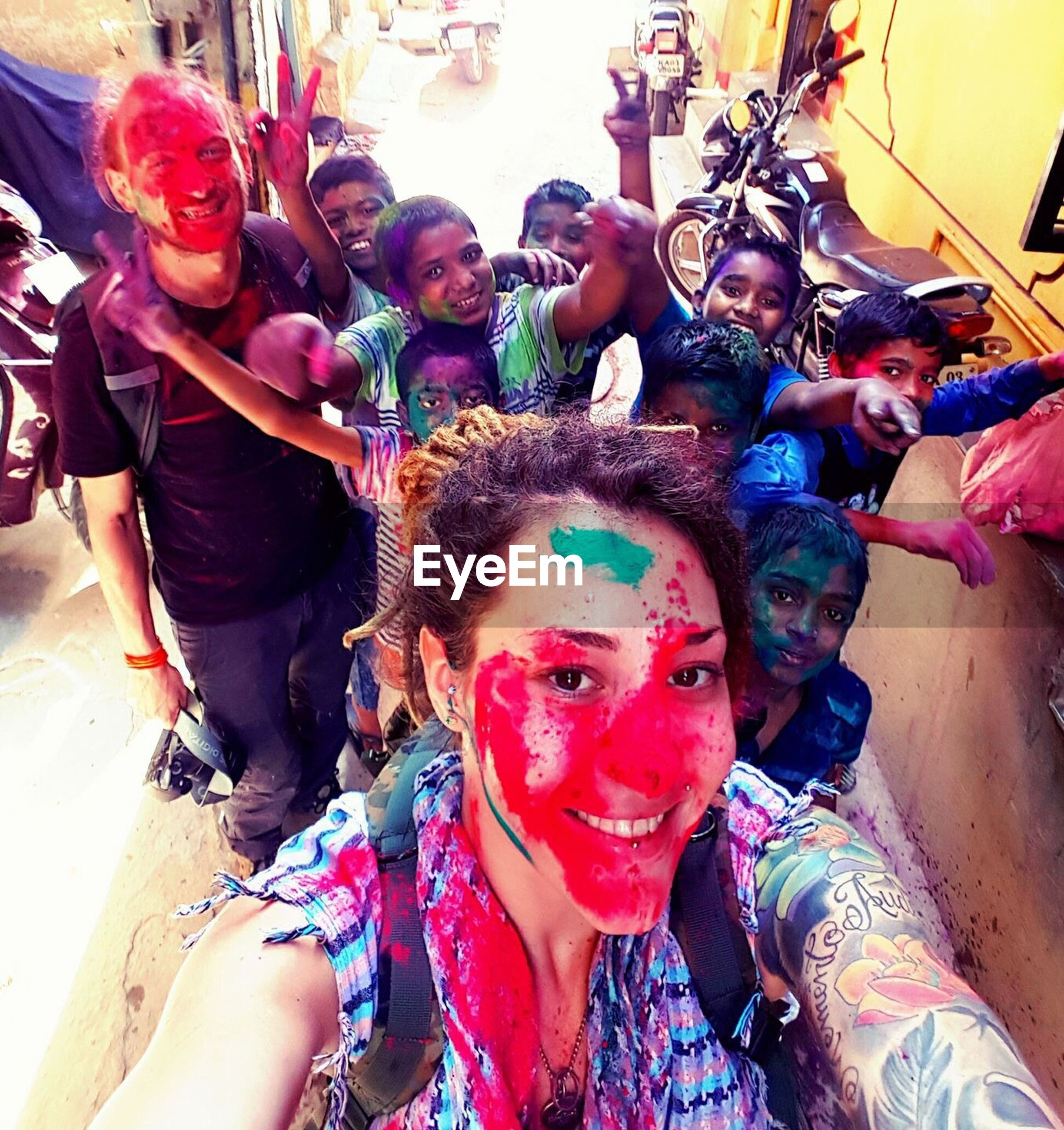 celebration, fun, holi, enjoyment, traditional festival, multi colored, cultures, cheerful, adults only, real people, happiness, face paint, party - social event, people, adult, event, friendship, outdoors, elephant, day, togetherness, powder paint