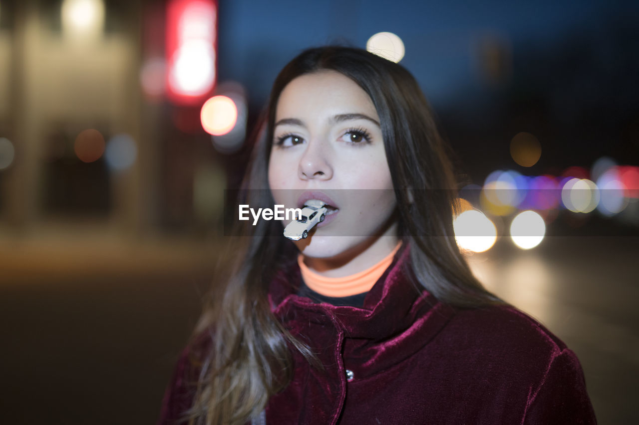 portrait, young adult, illuminated, one person, young women, headshot, lifestyles, focus on foreground, night, leisure activity, front view, real people, looking away, long hair, hair, casual clothing, light - natural phenomenon, hairstyle, beautiful woman, scarf