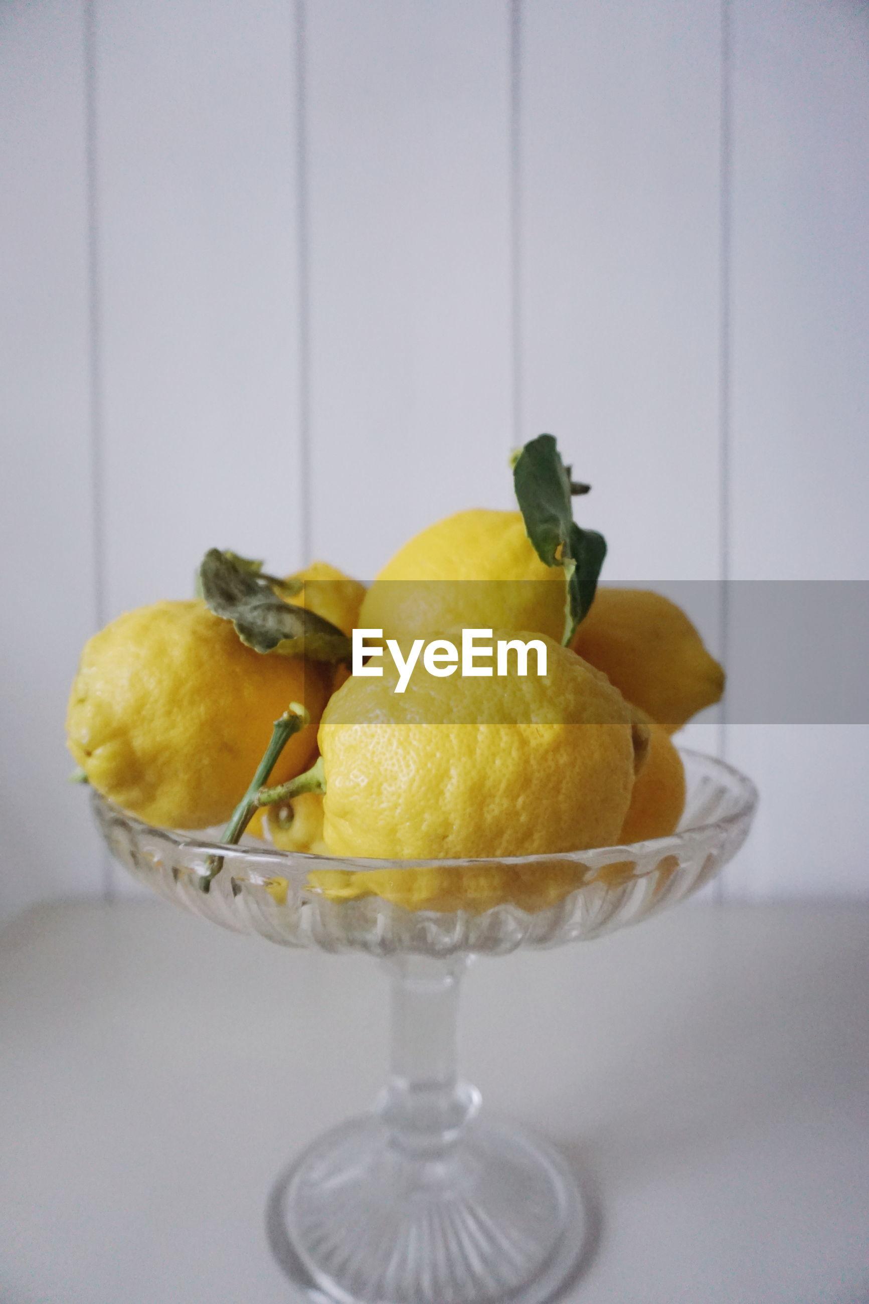 Close-up of lemons in bowl