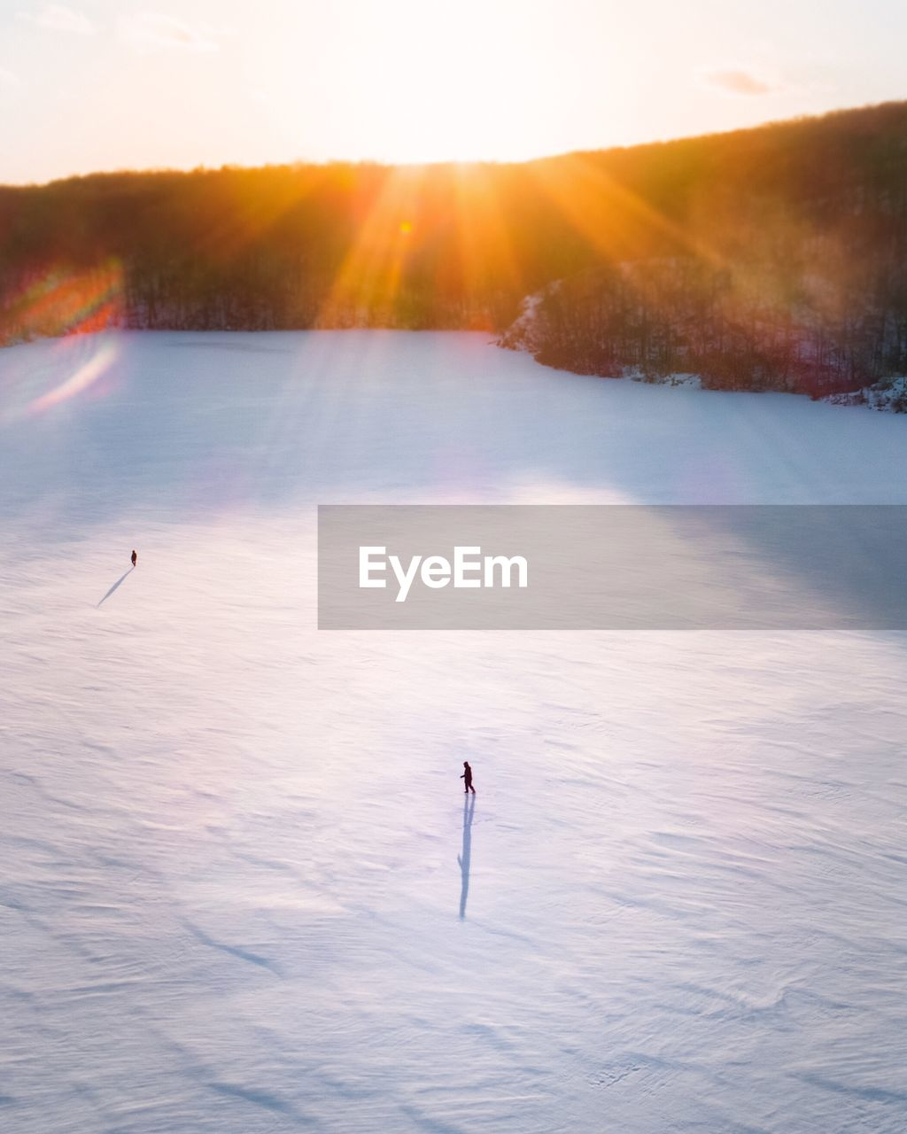 High angle view of snow covered field on sunny day