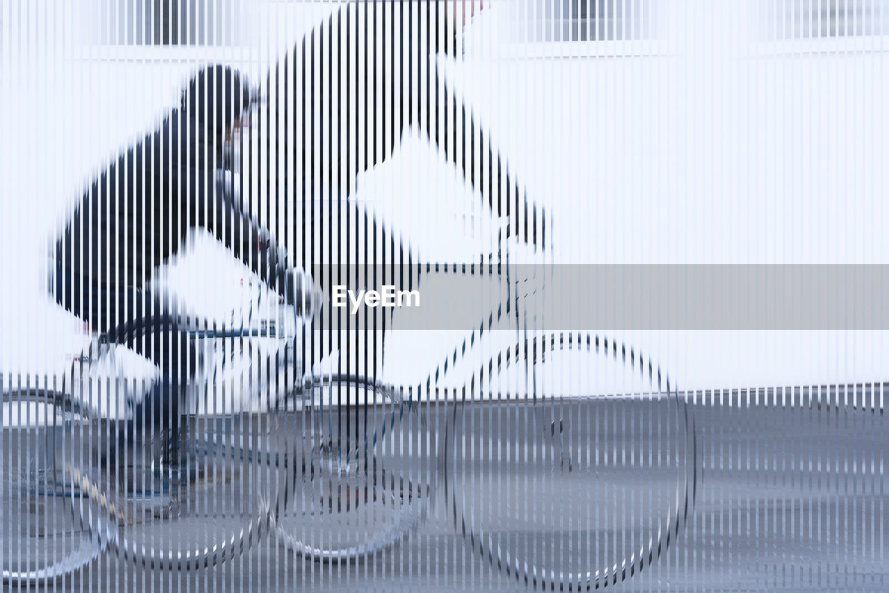 Multiple image of man riding bicycle on land