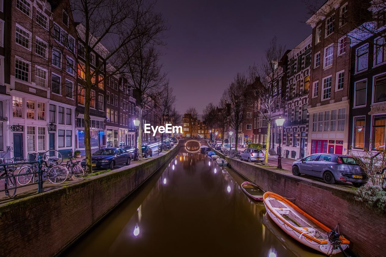 illuminated, night, architecture, built structure, transportation, building exterior, tree, canal, bare tree, city, road, outdoors, sky, no people