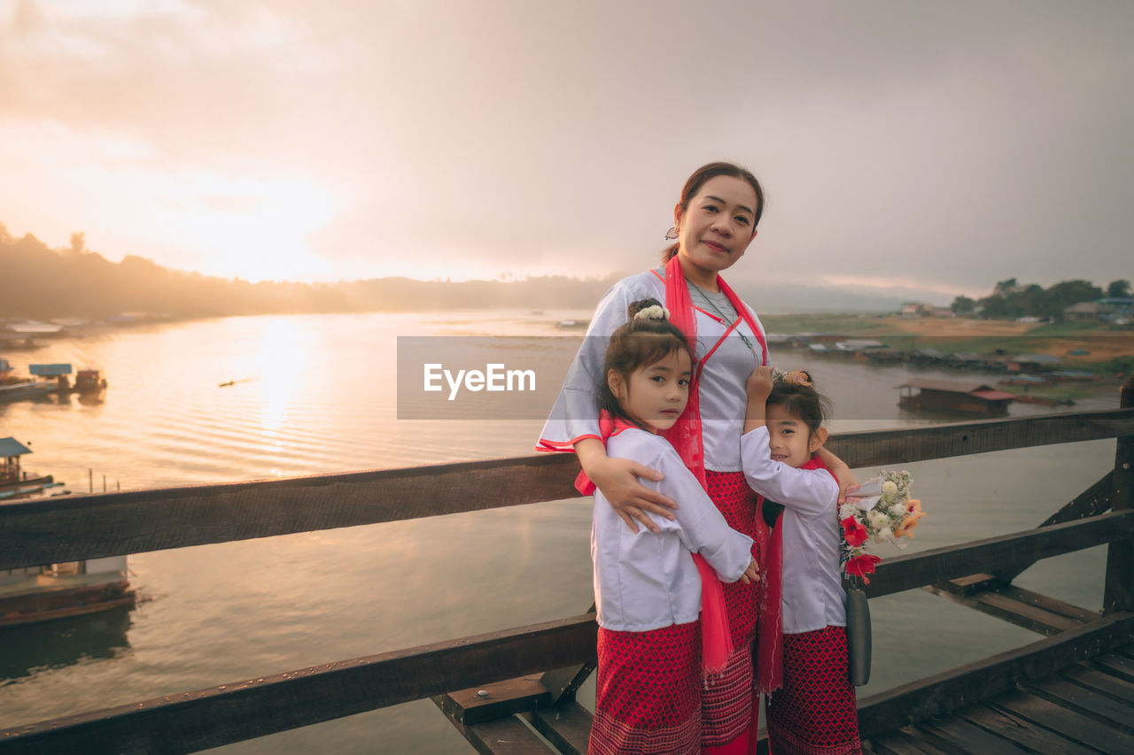 Woman with daughter get dress traditional costume of mon tribal at mon village