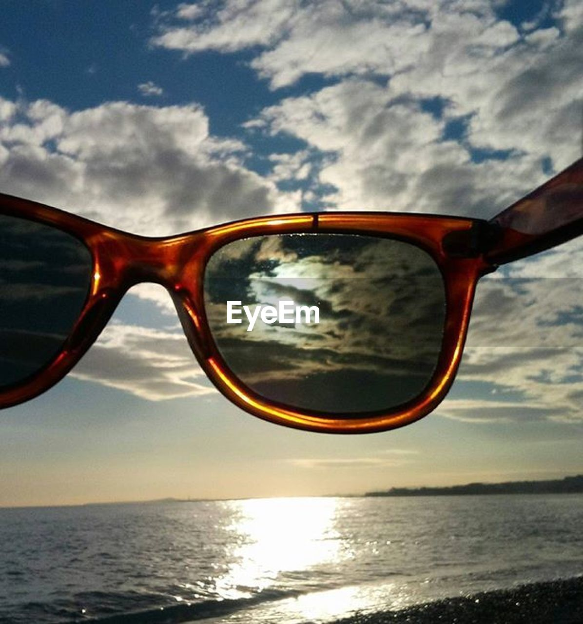 sunglasses, reflection, eyewear, eyeglasses, vision, sky, glasses, cloud - sky, eyesight, cool, nature, water, tranquil scene, no people, outdoors, day, sea, close-up