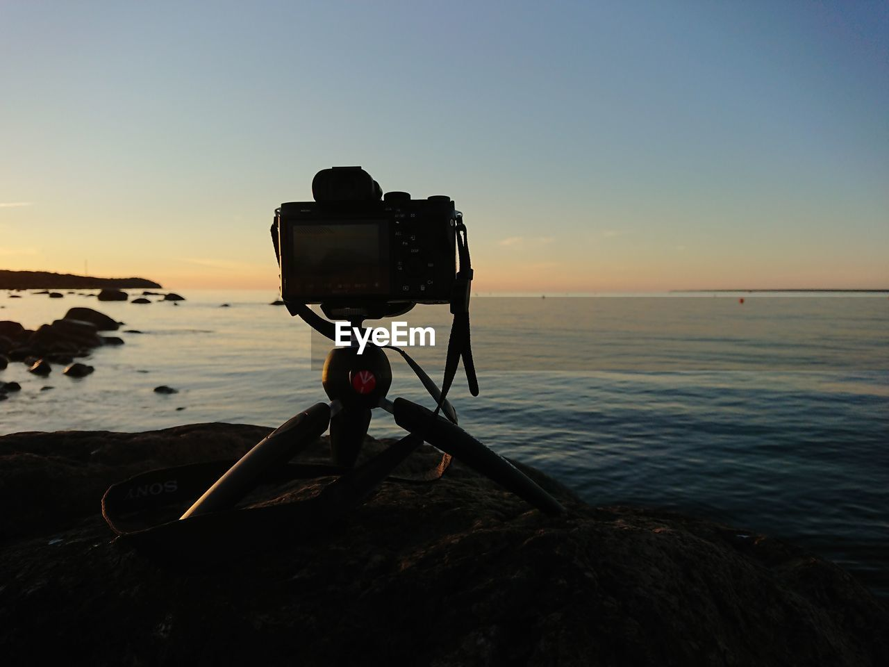 sunset, photography themes, camera - photographic equipment, sea, technology, water, nature, beauty in nature, digital camera, photographing, digital single-lens reflex camera, tranquil scene, scenics, no people, horizon over water, tranquility, sky, outdoors, camera, clear sky, slr camera, close-up, day