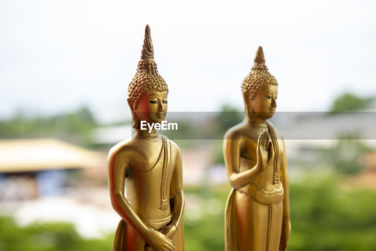 religion, spirituality, sculpture, belief, statue, representation, human representation, art and craft, male likeness, no people, place of worship, focus on foreground, creativity, built structure, day, architecture, gold colored, idol