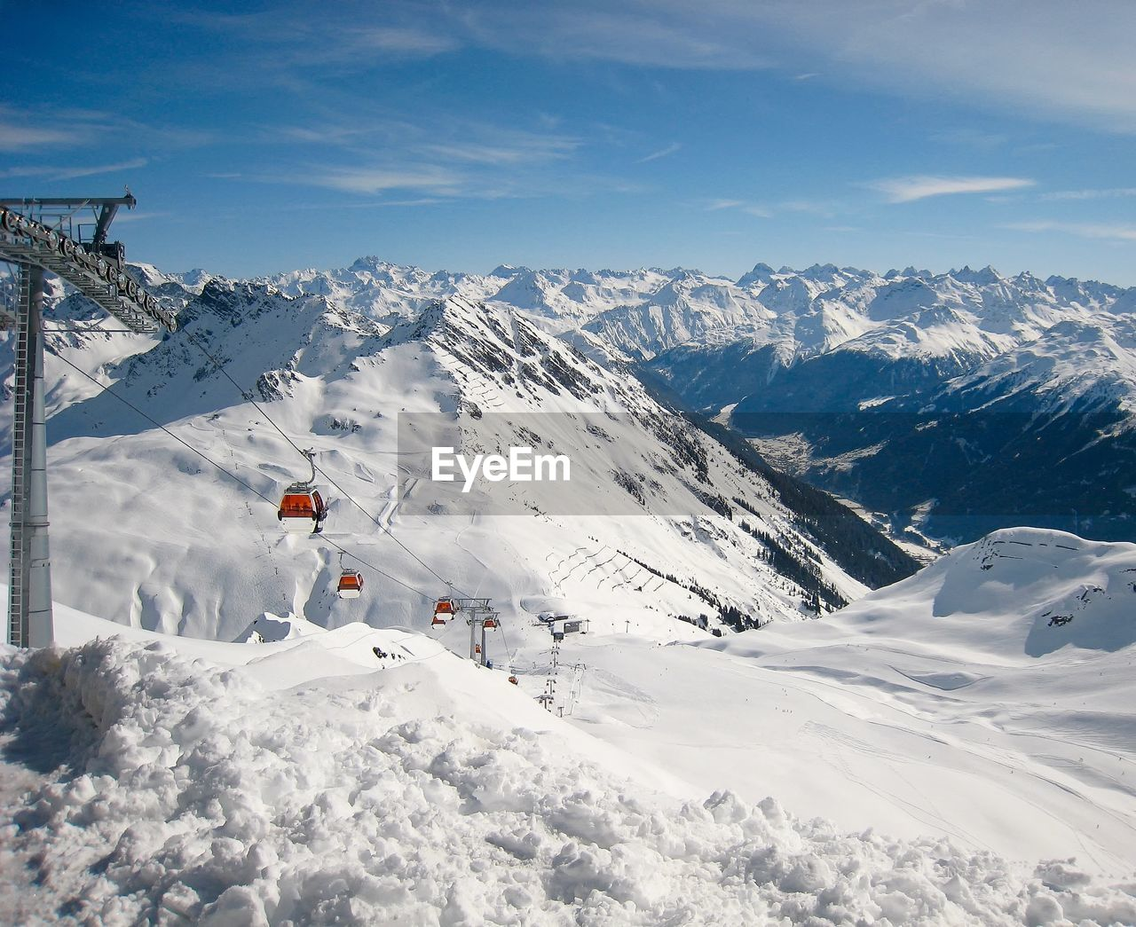 Ski Lifts Against Snowcapped Mountains