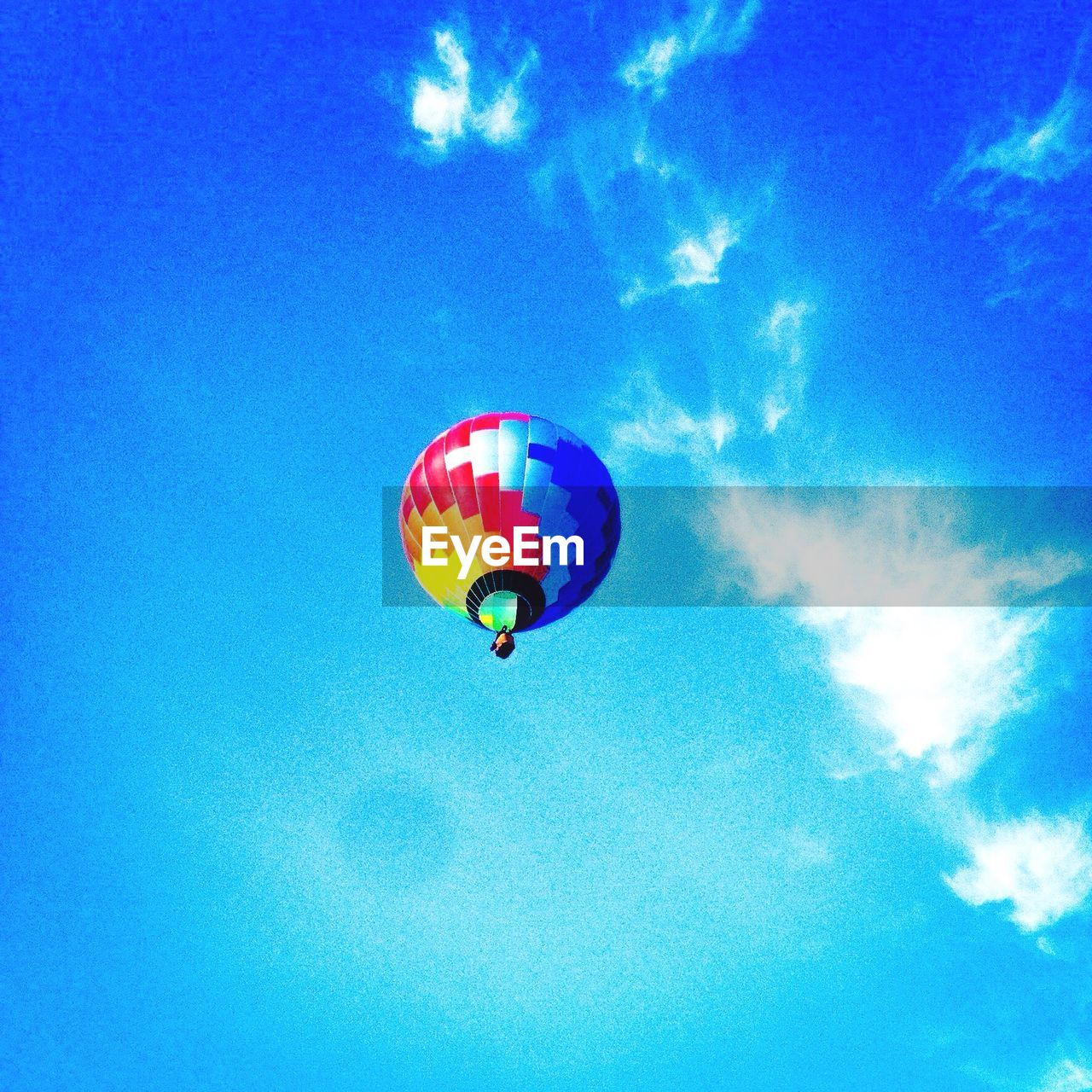 blue, mid-air, low angle view, sky, multi colored, cloud - sky, adventure, flying, day, parachute, outdoors, skydiving, nature, extreme sports, no people, beauty in nature, hot air balloon