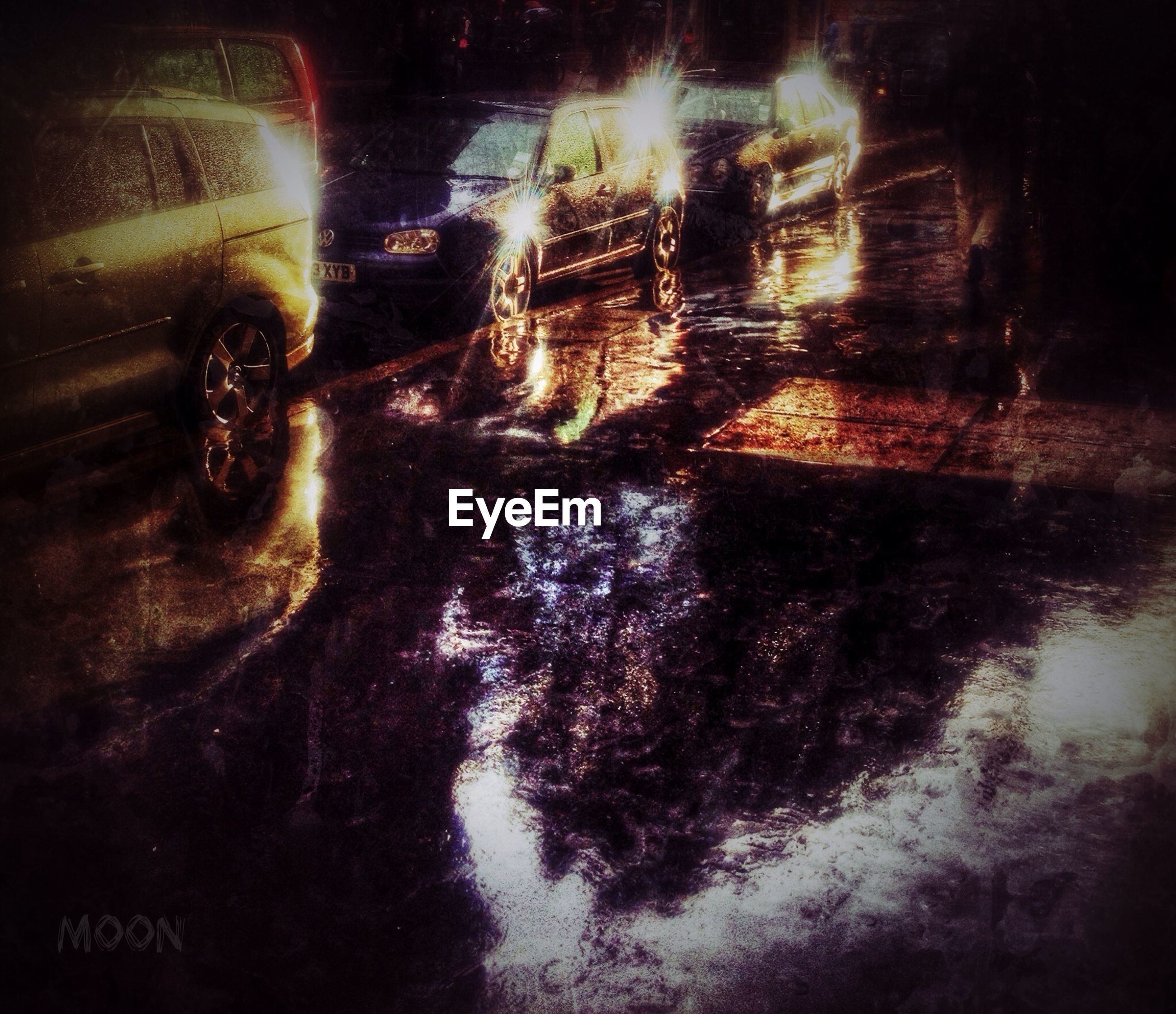 transportation, land vehicle, street, mode of transport, car, road, night, auto post production filter, wet, transfer print, reflection, outdoors, illuminated, rain, high angle view, travel, puddle, architecture, on the move