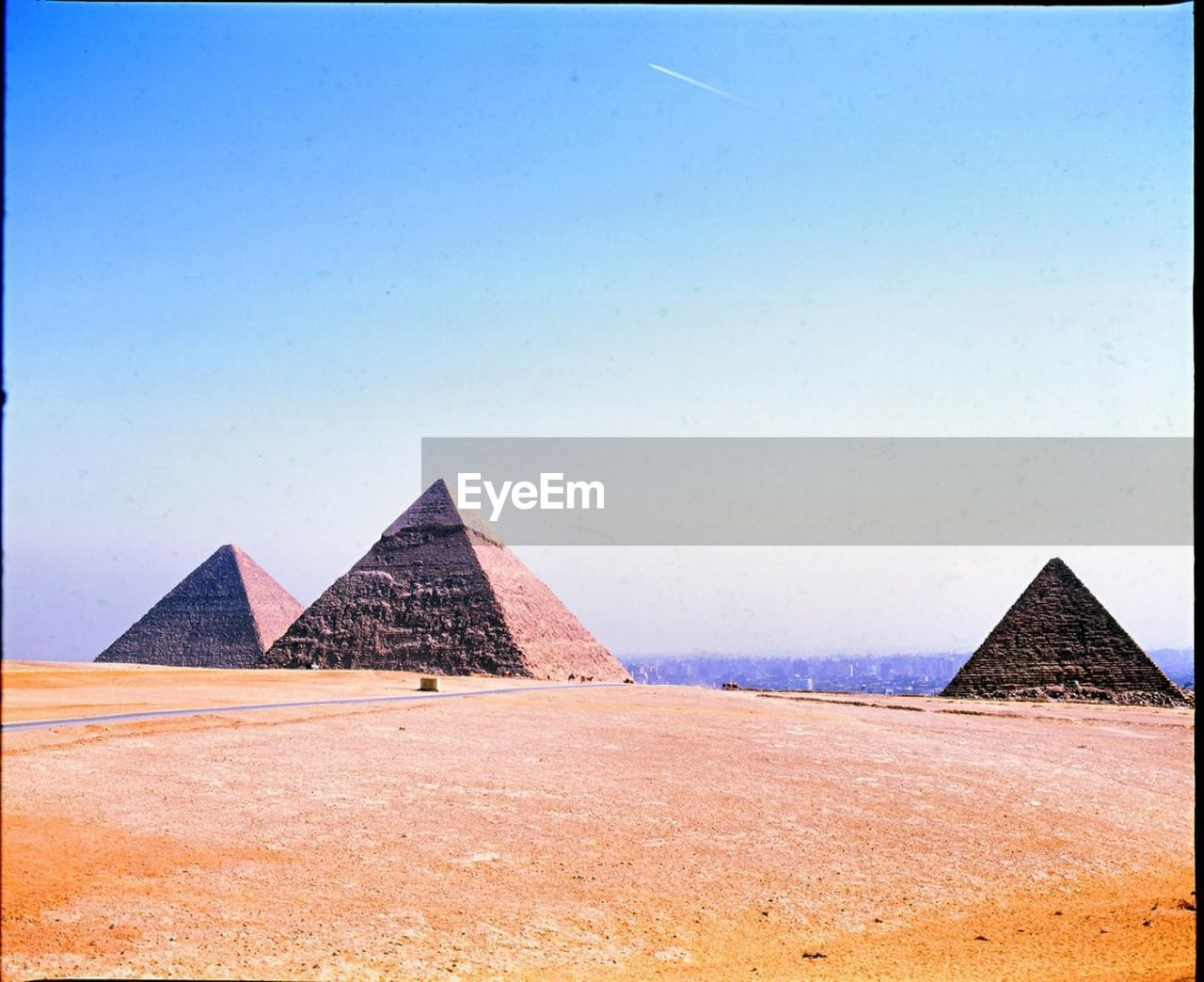 pyramid, architecture, ancient, ancient civilization, history, built structure, triangle shape, travel destinations, the past, building exterior, sand, clear sky, tranquil scene, day, tranquility, no people, outdoors, desert, sky, nature