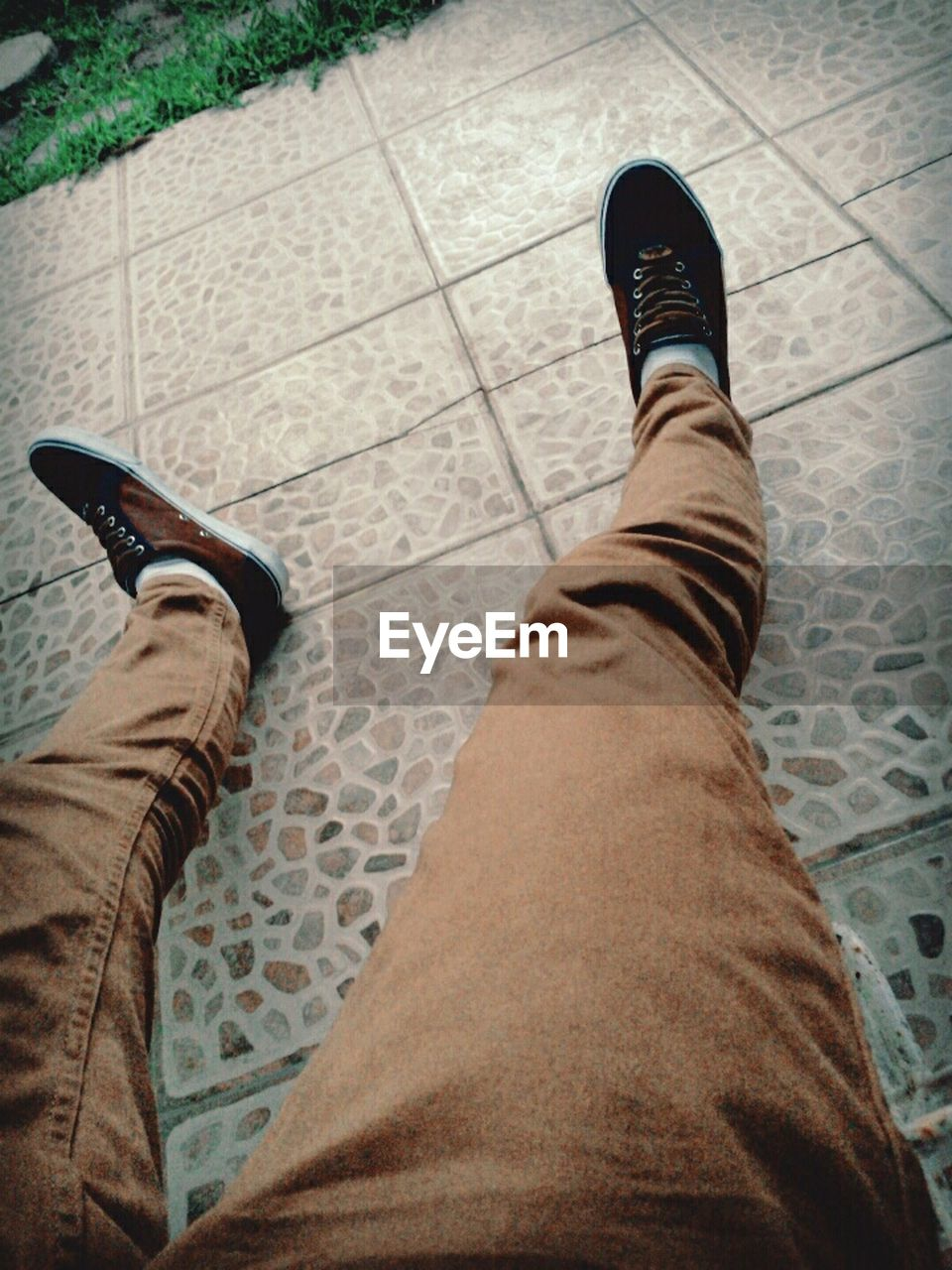 human leg, low section, personal perspective, real people, shoe, men, human body part, standing, high angle view, footpath, walking, lifestyles, outdoors, day, sidewalk, adult, people, adults only