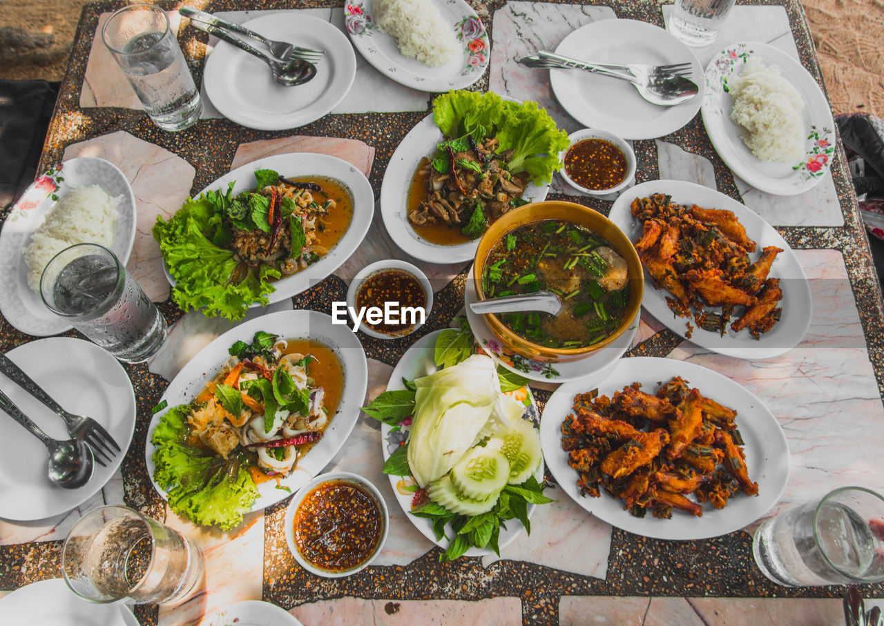 High Angle View Of Fresh Meal Served On Table At Restaurant