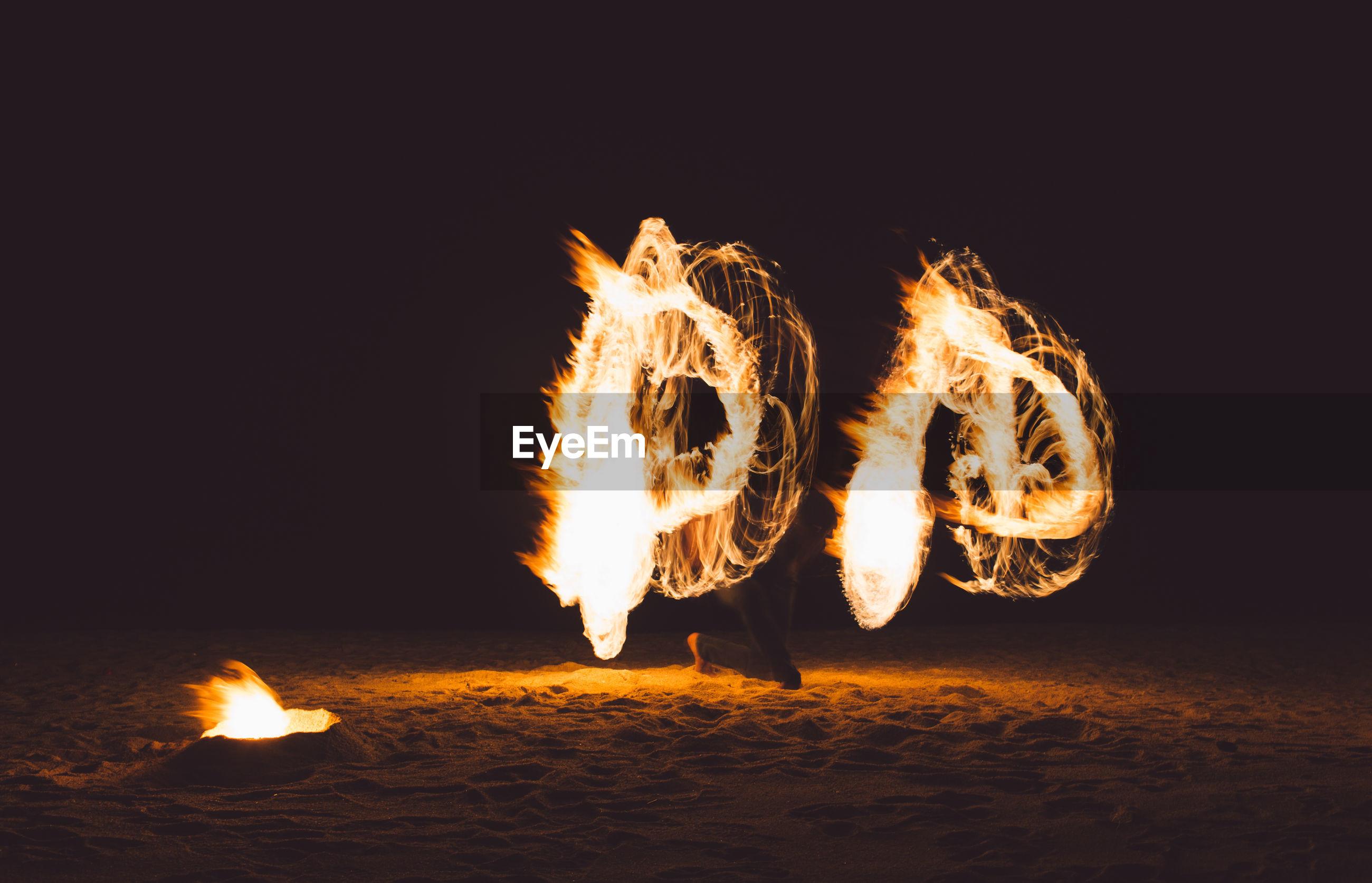 Bonfire on beach at night