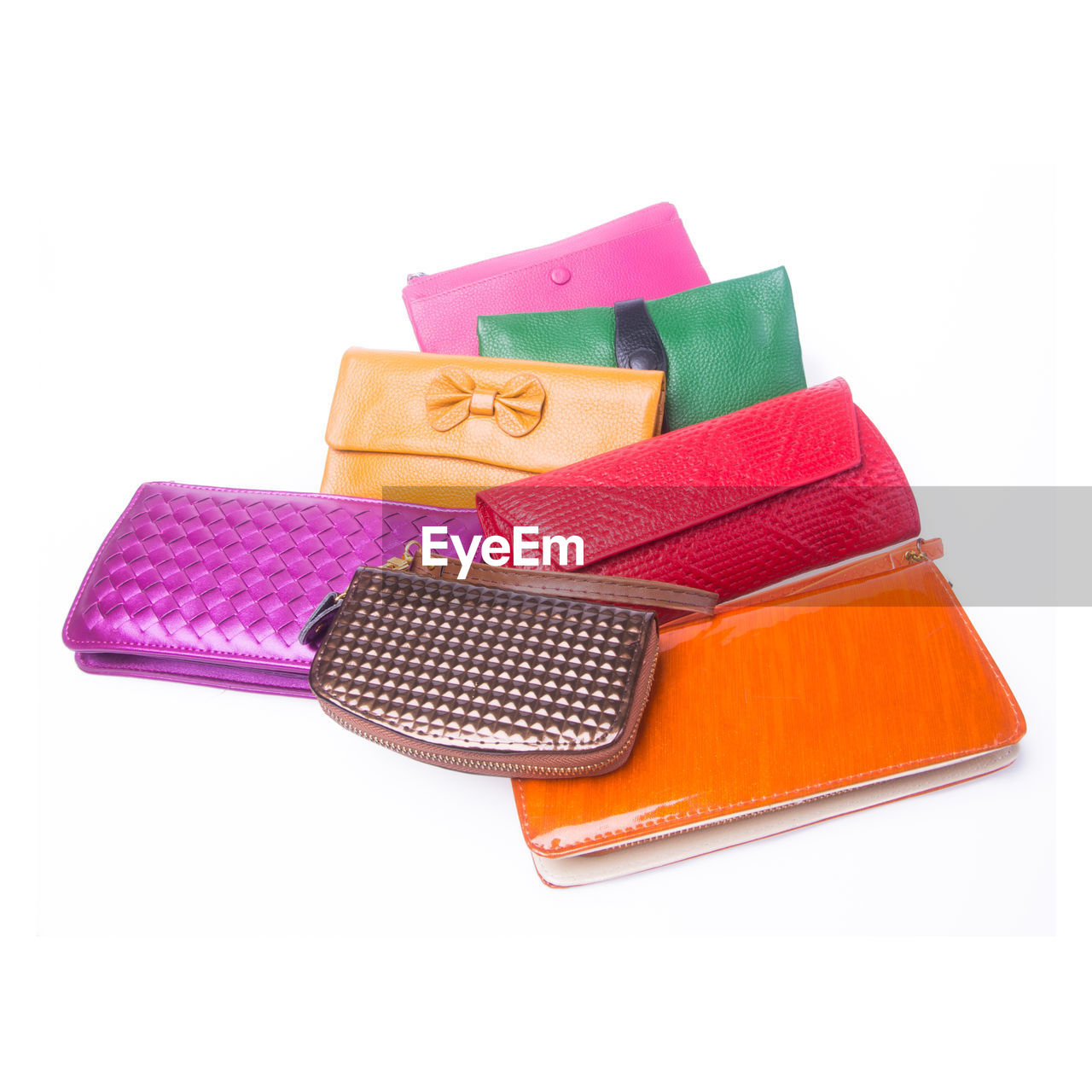 Colorful purses on white background