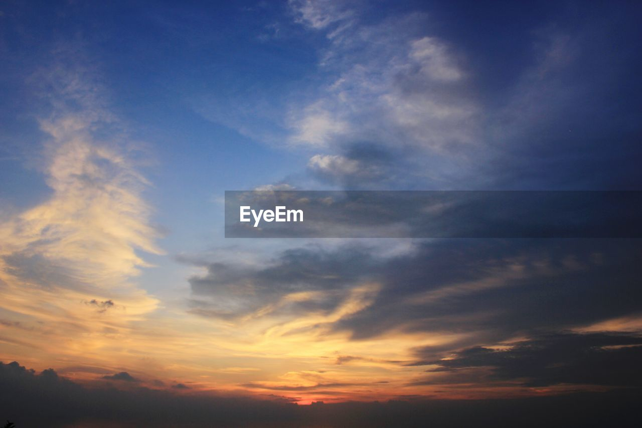 sunset, beauty in nature, sky, scenics, cloud - sky, nature, tranquil scene, tranquility, dramatic sky, majestic, idyllic, no people, outdoors, low angle view, blue, backgrounds, sky only, awe, day