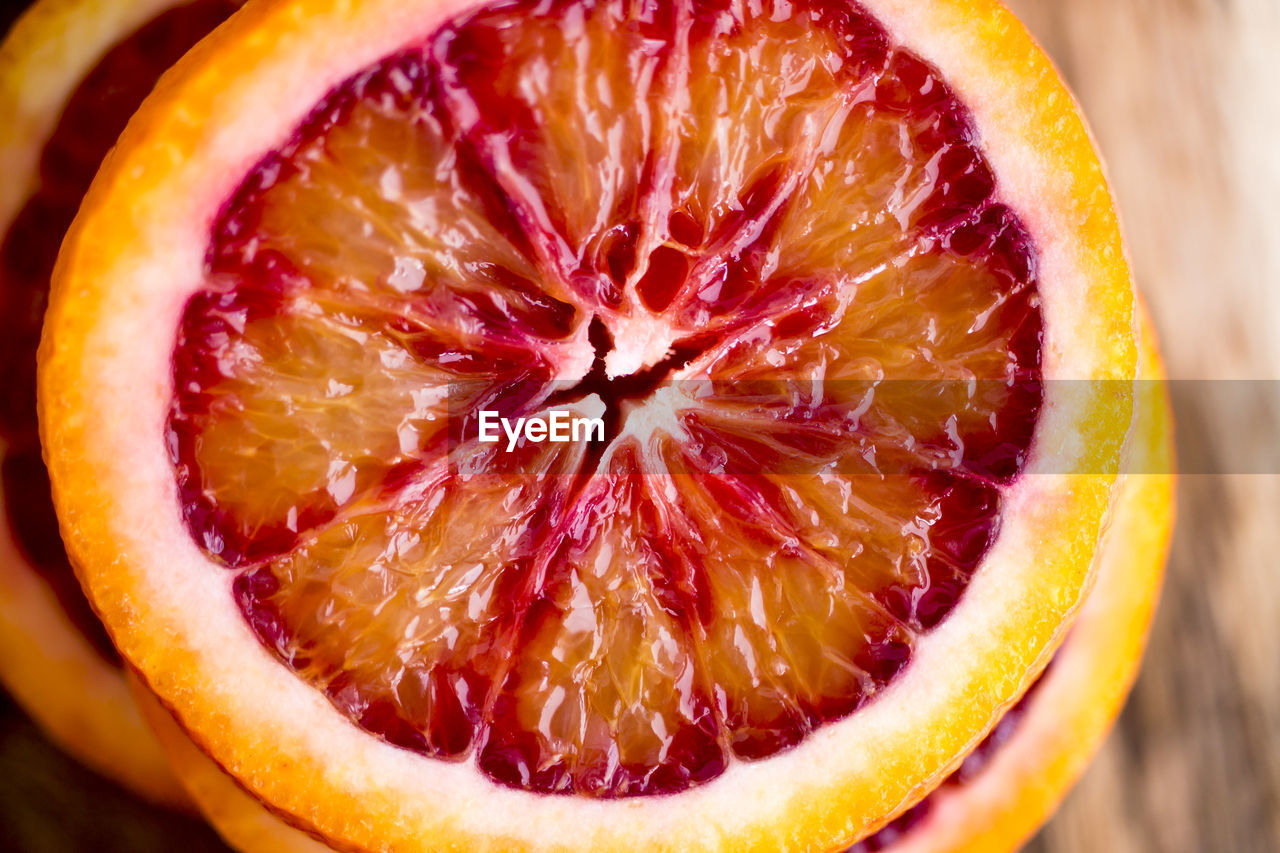 food and drink, food, healthy eating, fruit, cross section, wellbeing, freshness, slice, close-up, no people, indoors, still life, juicy, blood orange, red, halved, citrus fruit, ripe, single object, focus on foreground, orange, antioxidant, vitamin c