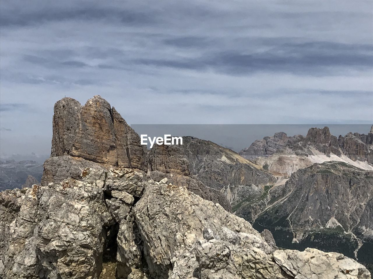 rock, rock - object, cloud - sky, mountain, solid, rock formation, sky, scenics - nature, mountain range, beauty in nature, tranquil scene, non-urban scene, nature, tranquility, formation, physical geography, rocky mountains, no people, day, geology, outdoors, mountain peak, eroded, arid climate