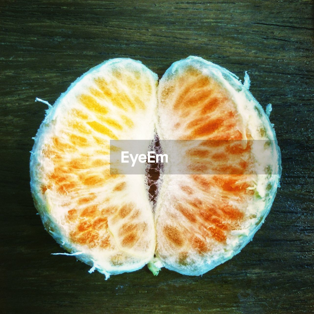 food and drink, still life, food, wellbeing, table, freshness, close-up, healthy eating, fruit, no people, indoors, slice, high angle view, directly above, wood - material, cross section, citrus fruit, day, single object, orange