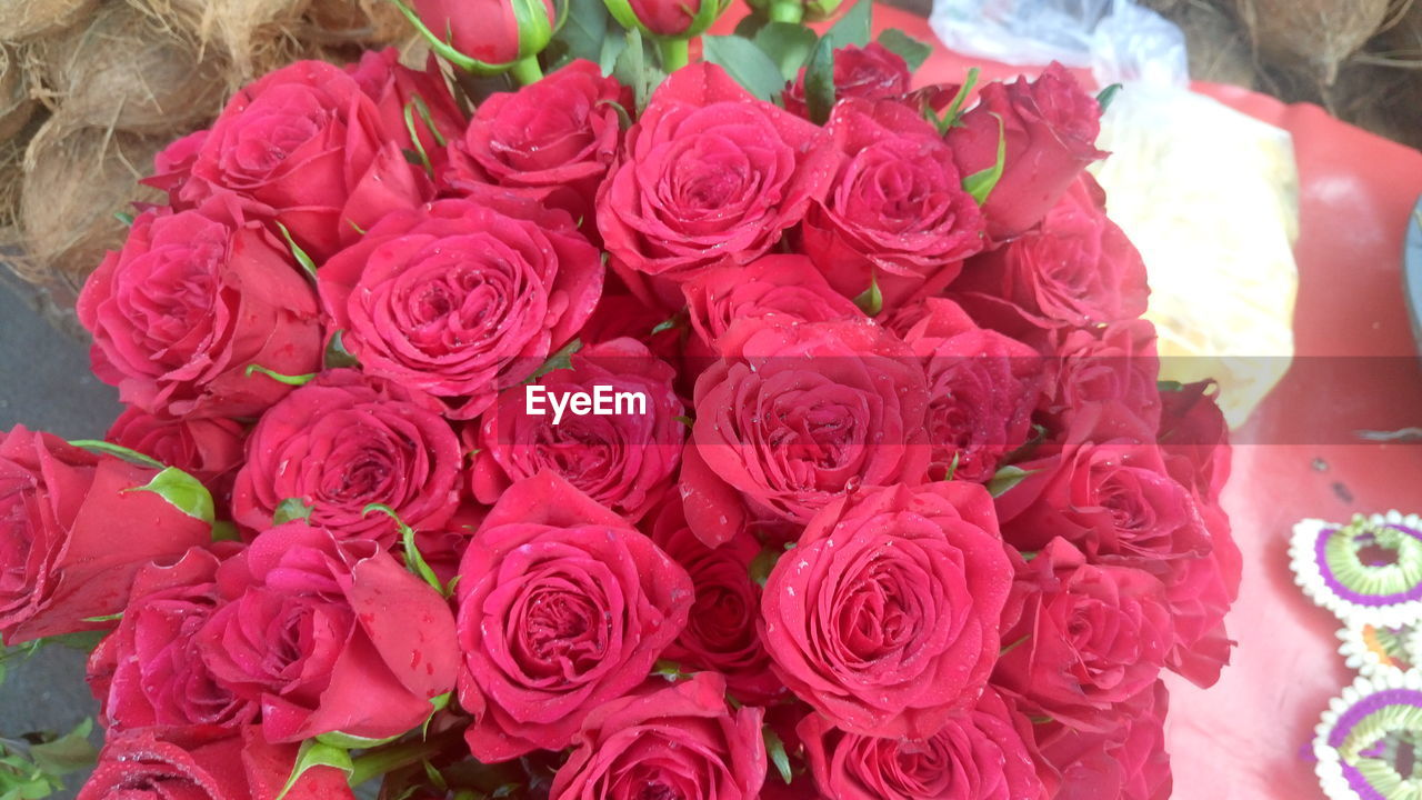 flower, rose - flower, retail, flower market, bouquet, for sale, high angle view, petal, freshness, fragility, variation, no people, market, celebration, flower head, flower shop, beauty in nature, nature, close-up, outdoors, day, florist