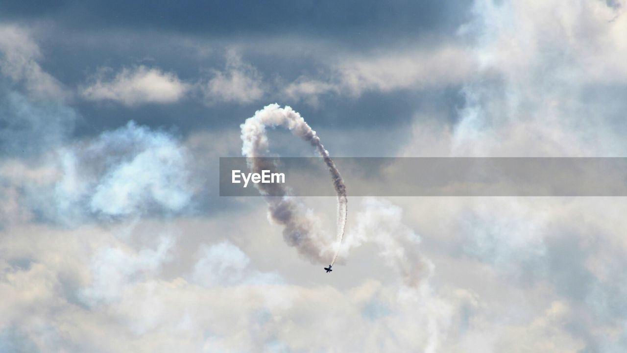 Airplane Flying Against Cloudy Sky