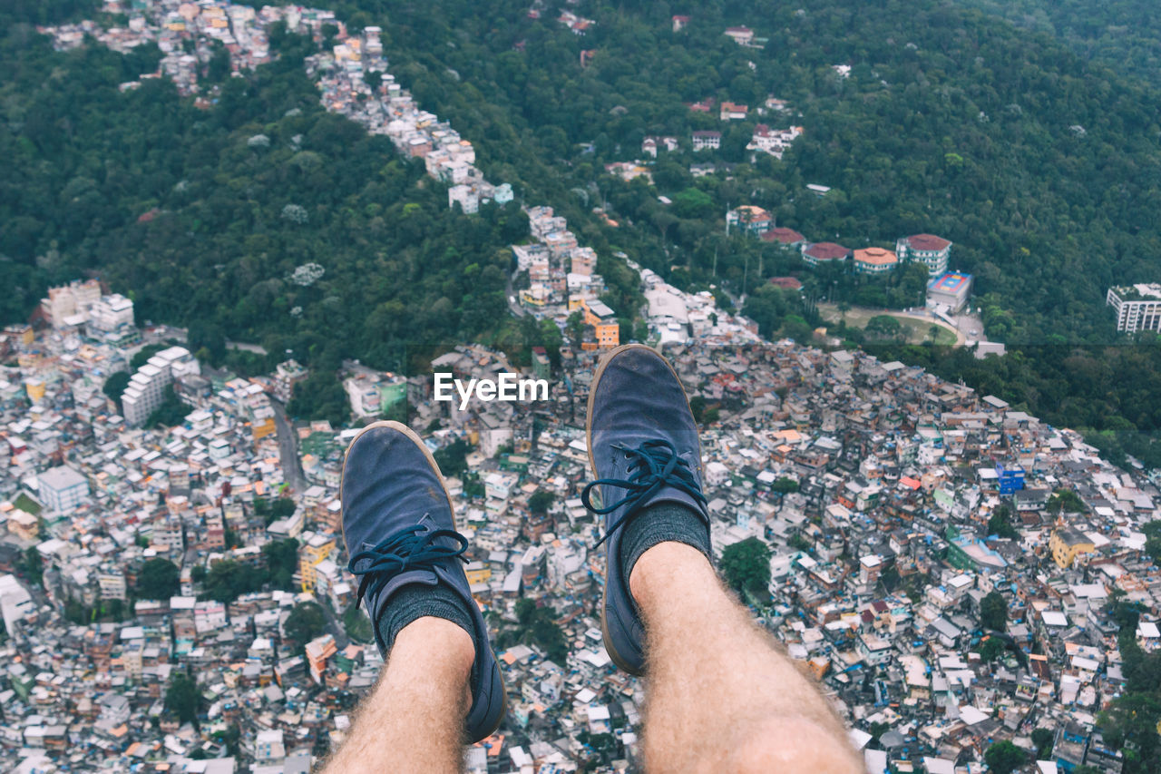 Low Section Of Man's Legs Above City