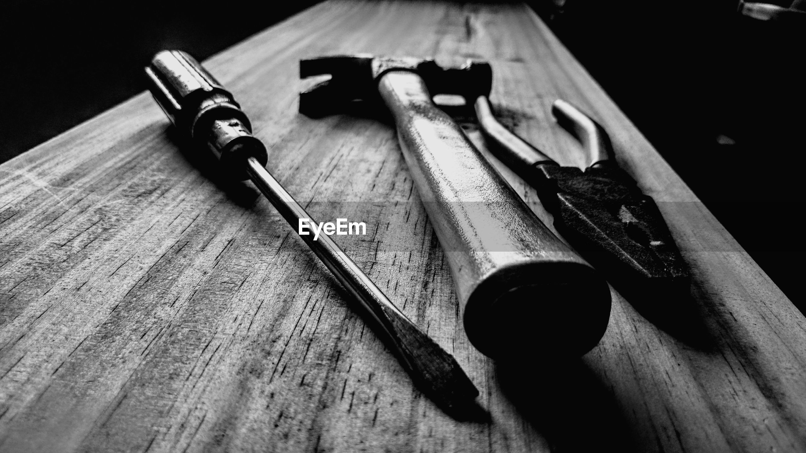 Close-up of tools on wooden table