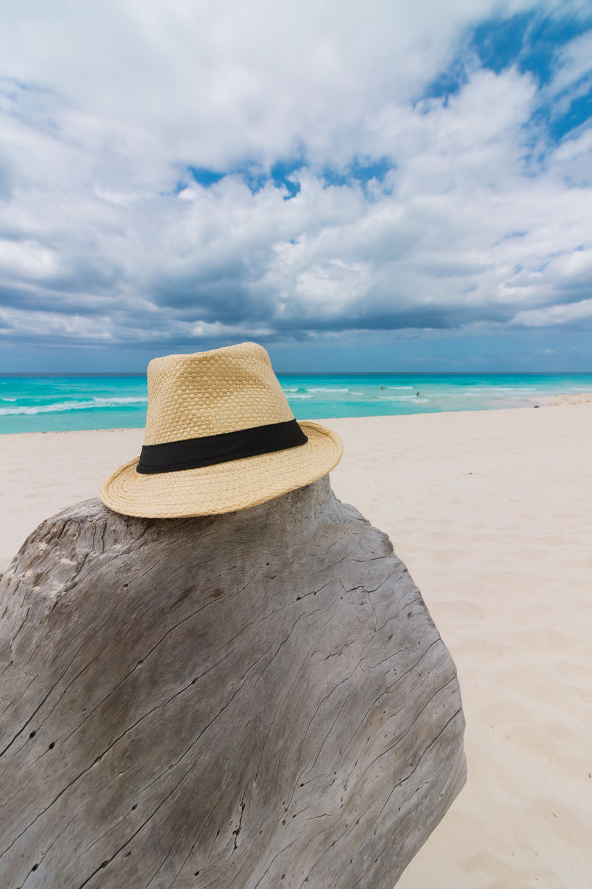 beach, sea, land, cloud - sky, sky, water, hat, scenics - nature, sand, beauty in nature, horizon over water, tranquil scene, tranquility, horizon, idyllic, nature, non-urban scene, day, clothing, outdoors