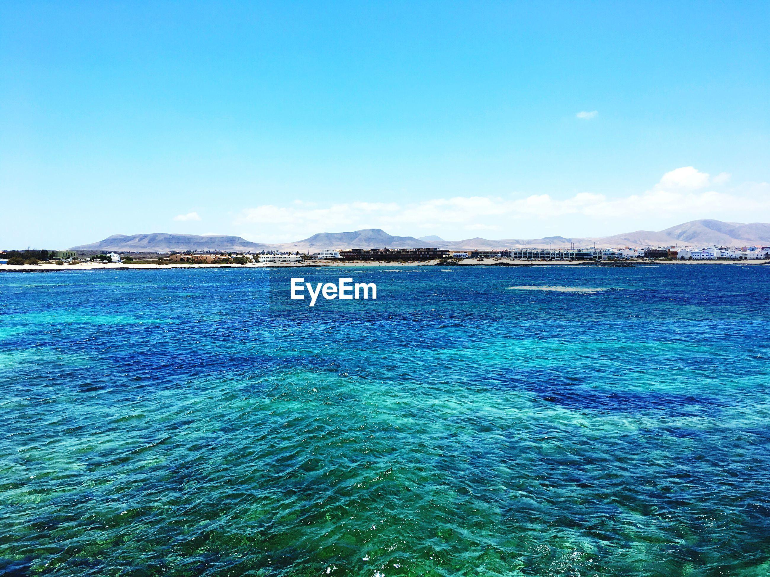 SEA AGAINST BLUE SKY