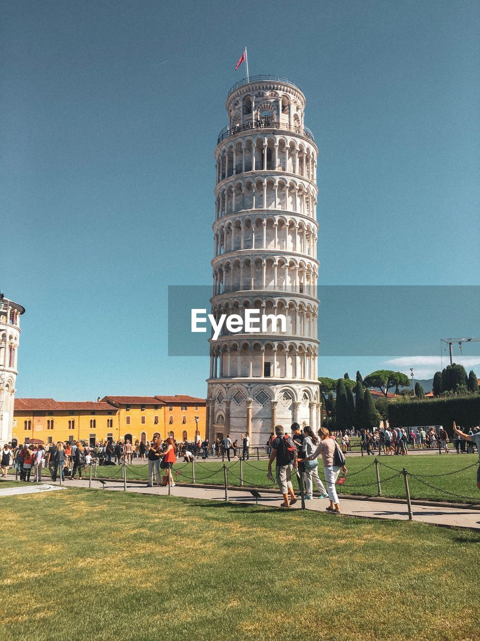 Leaning Tower Of Pisa Against Clear Blue Sky During Sunny Day