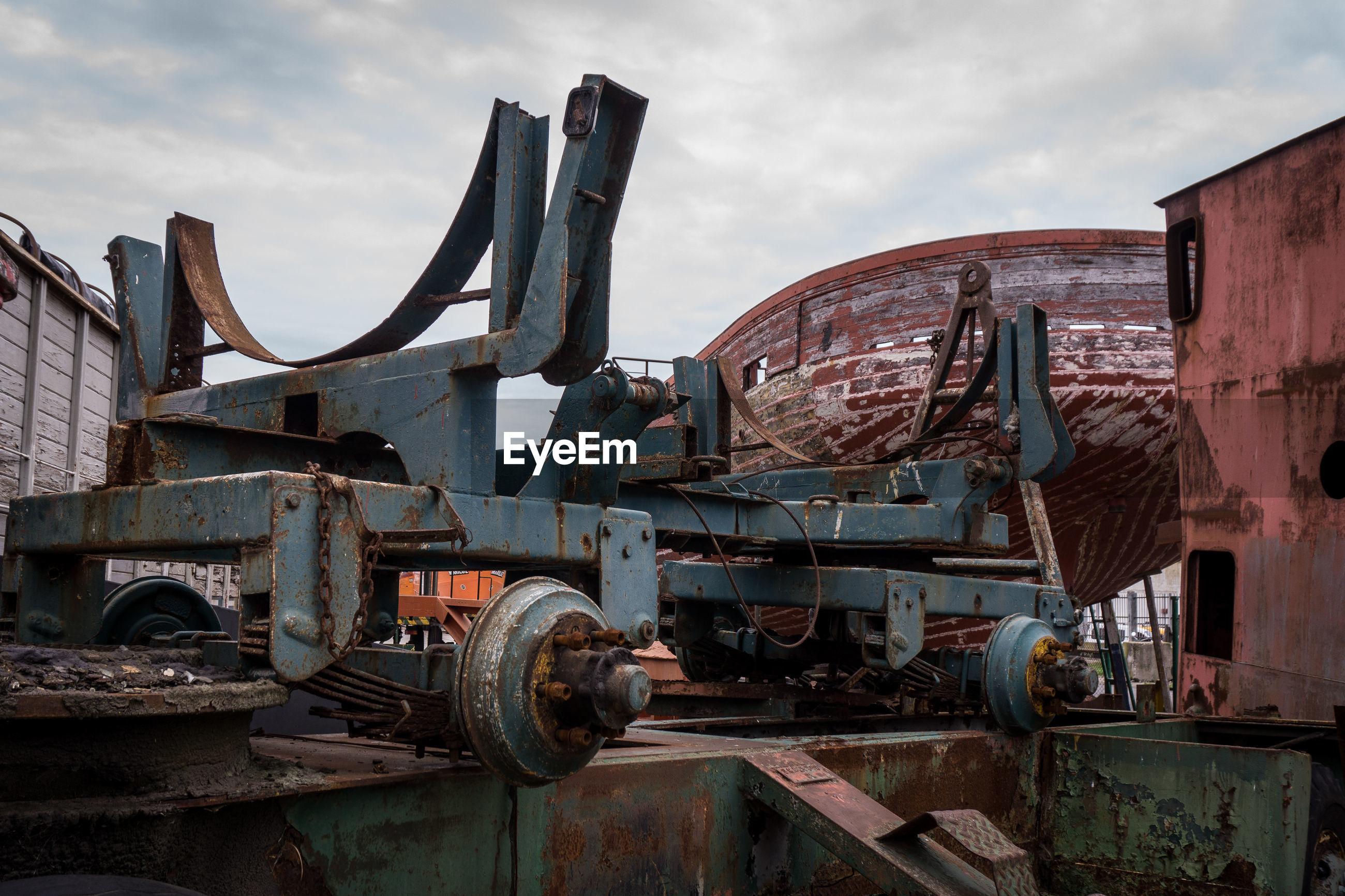 Abandoned rusty land vehicle against sky