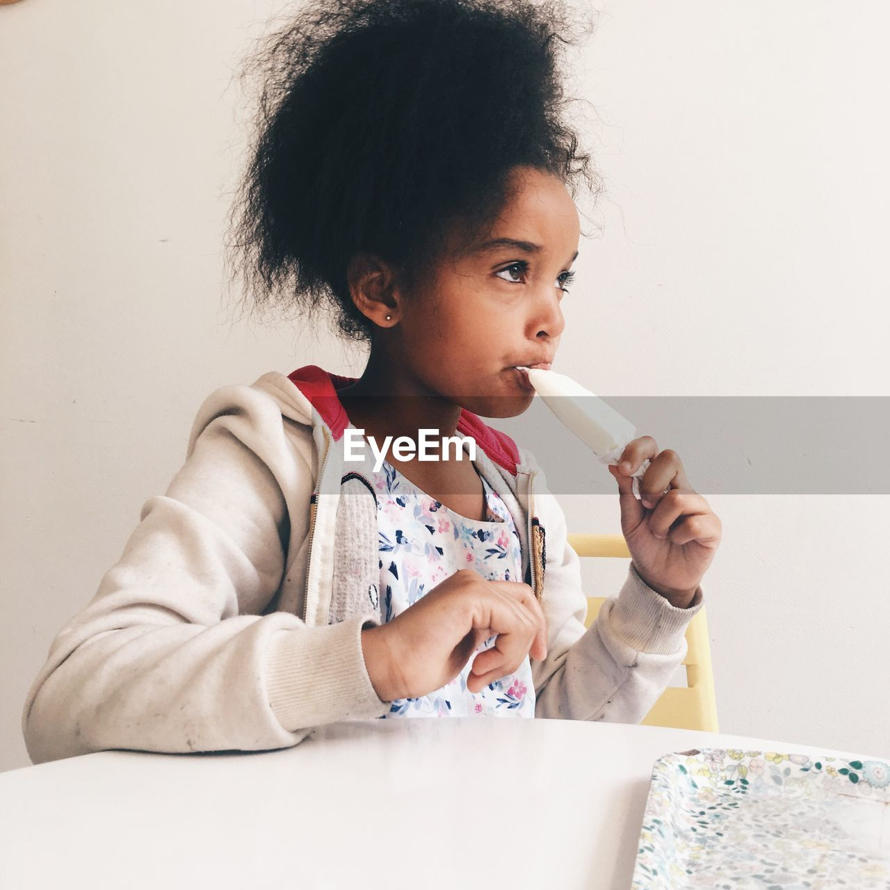 Portrait Of Cute Girl Eating Ice Cream
